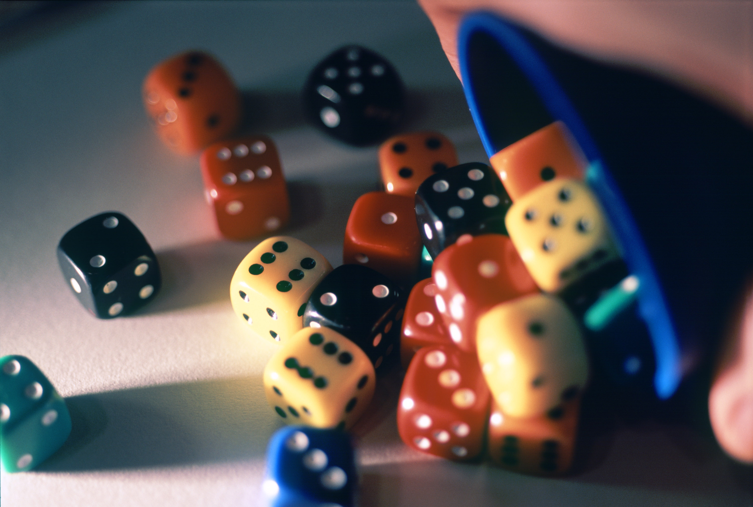 a cup full of dice, concept: board games at christmas