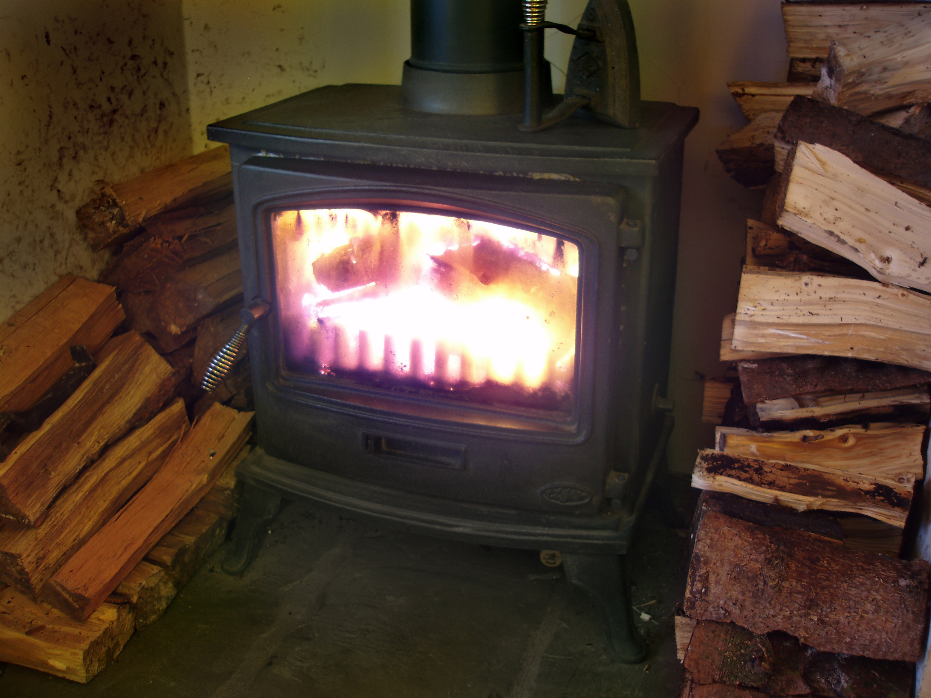 logs burning in a wood burning stove always reminds me of cosy christmas evening