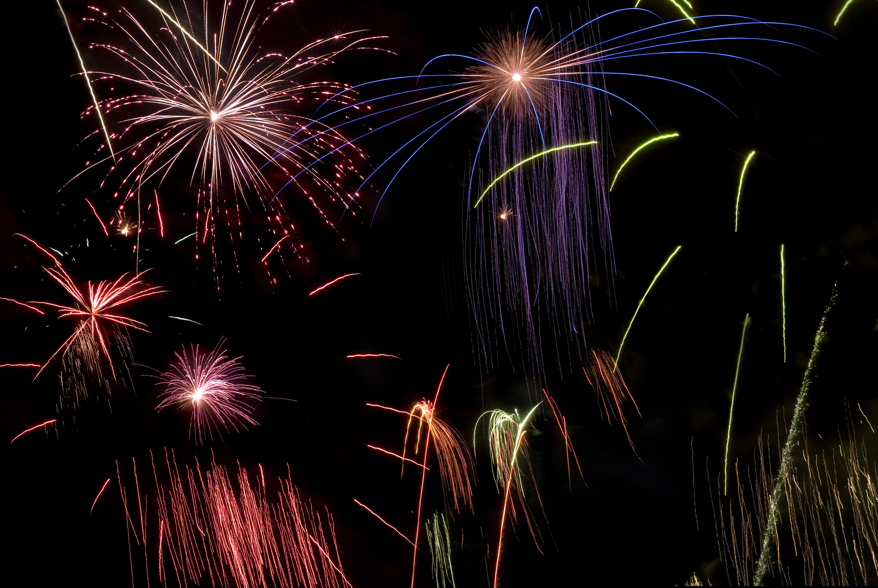 a background comprising on various firework explosions and colours
