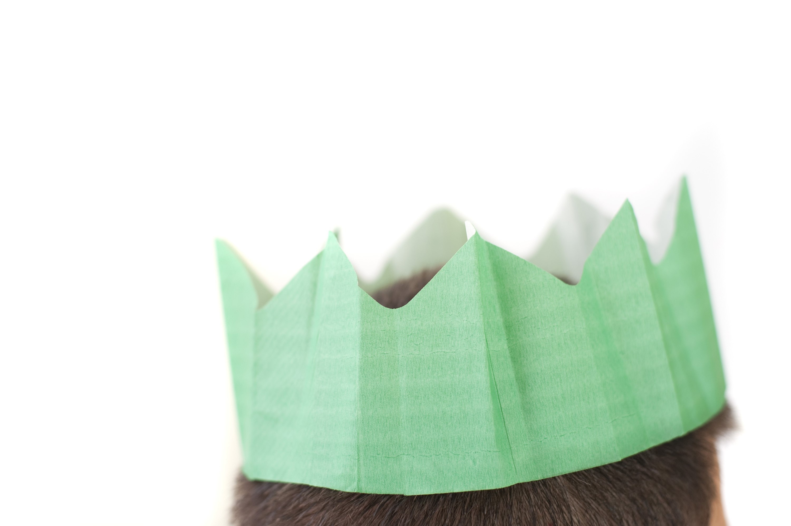 a green coloured paper christmas party hat