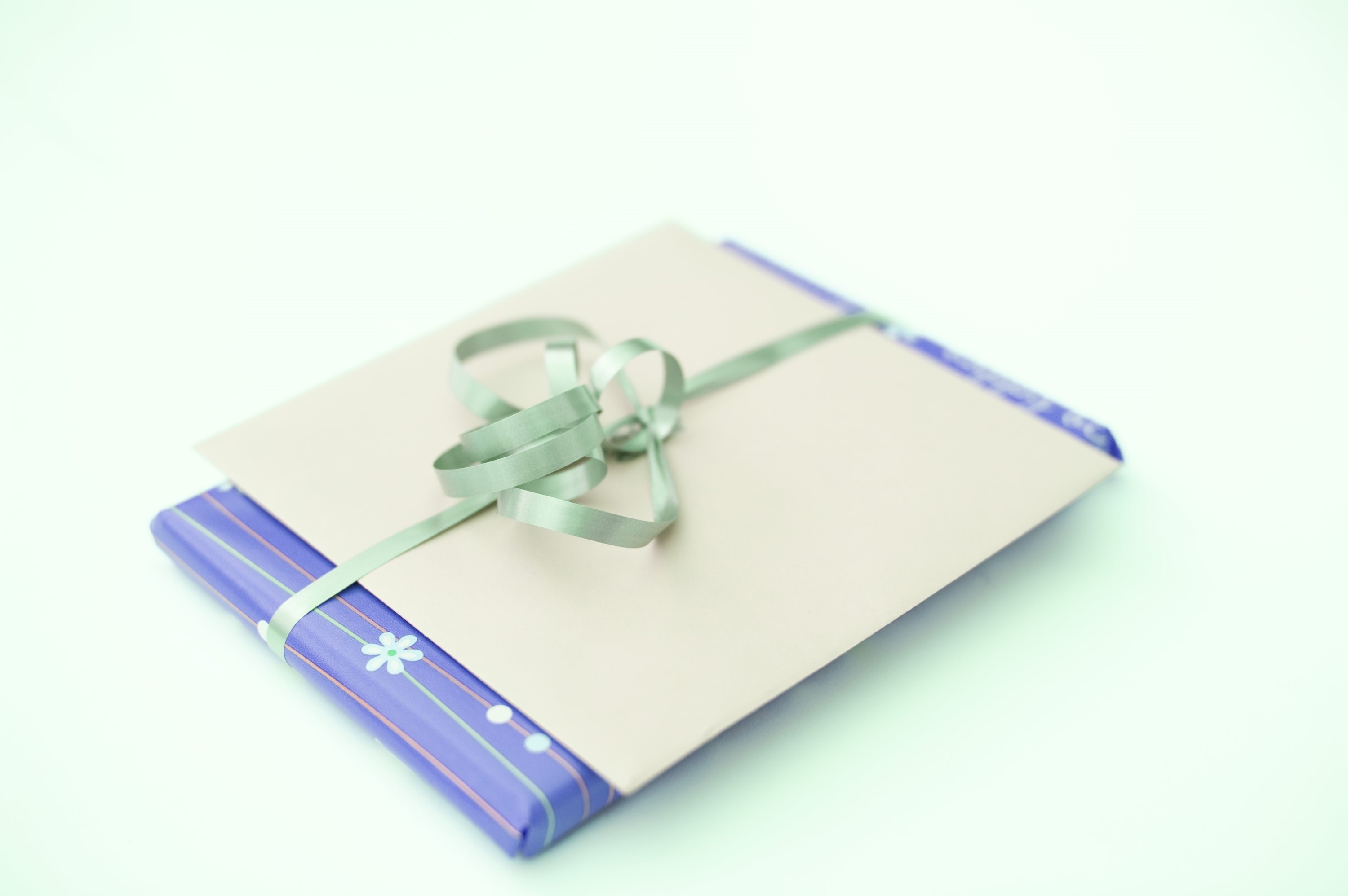 a christmas present and card tied with ribbon and a bow