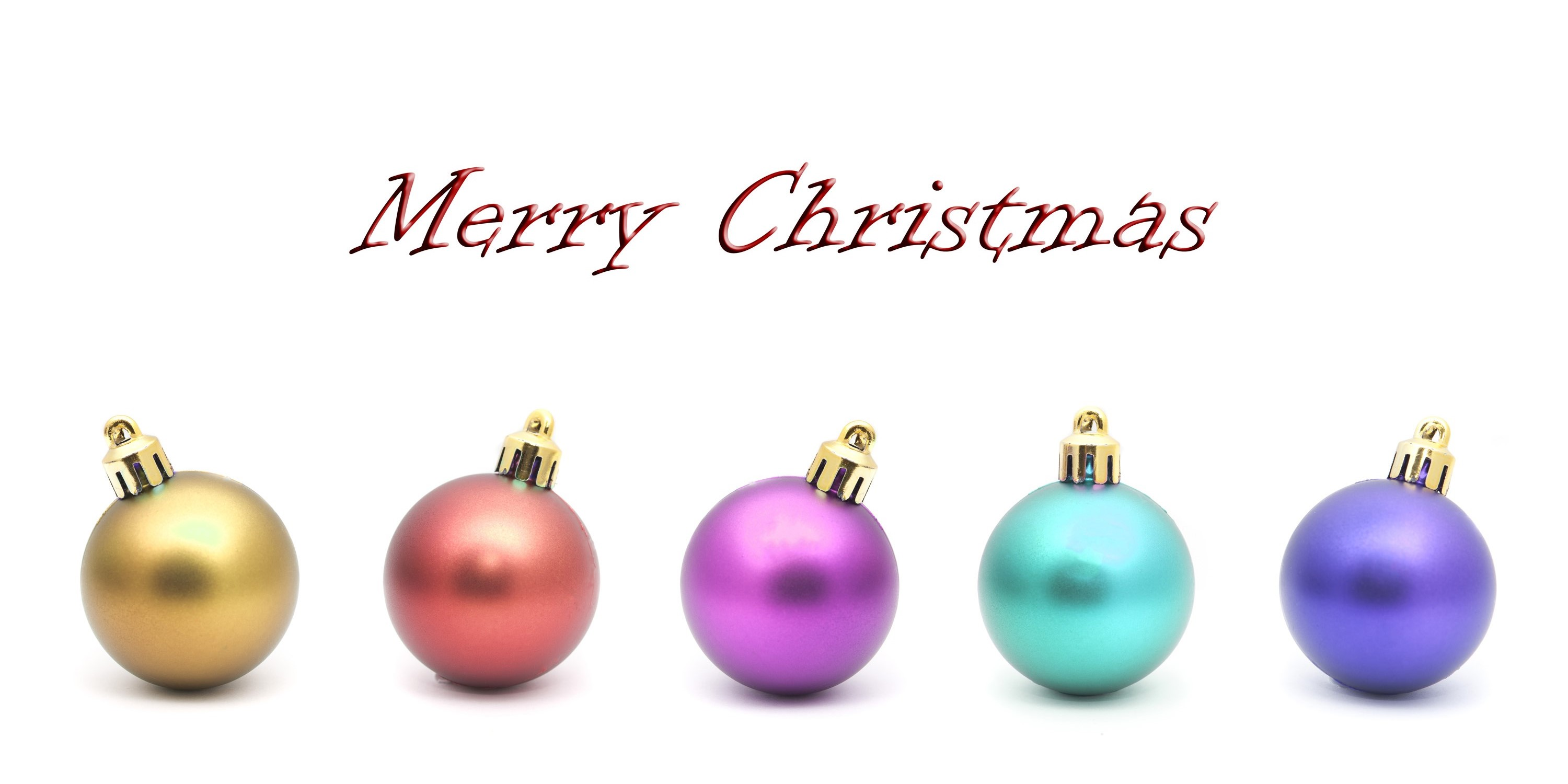 Merry Christmas greeting card with a row of colourful round baubles with shadow detail on a white background