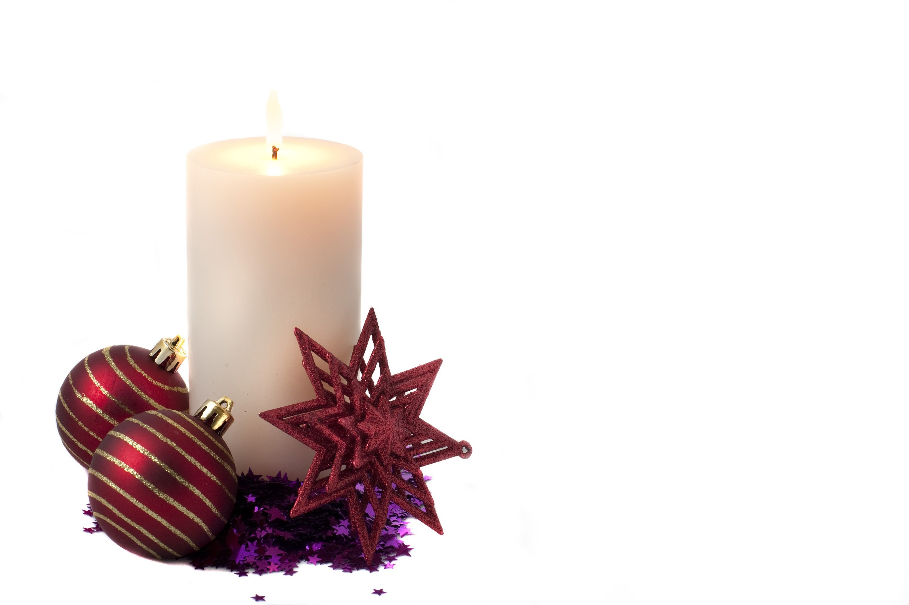 a burning christmas candle cutout on a white backdrop