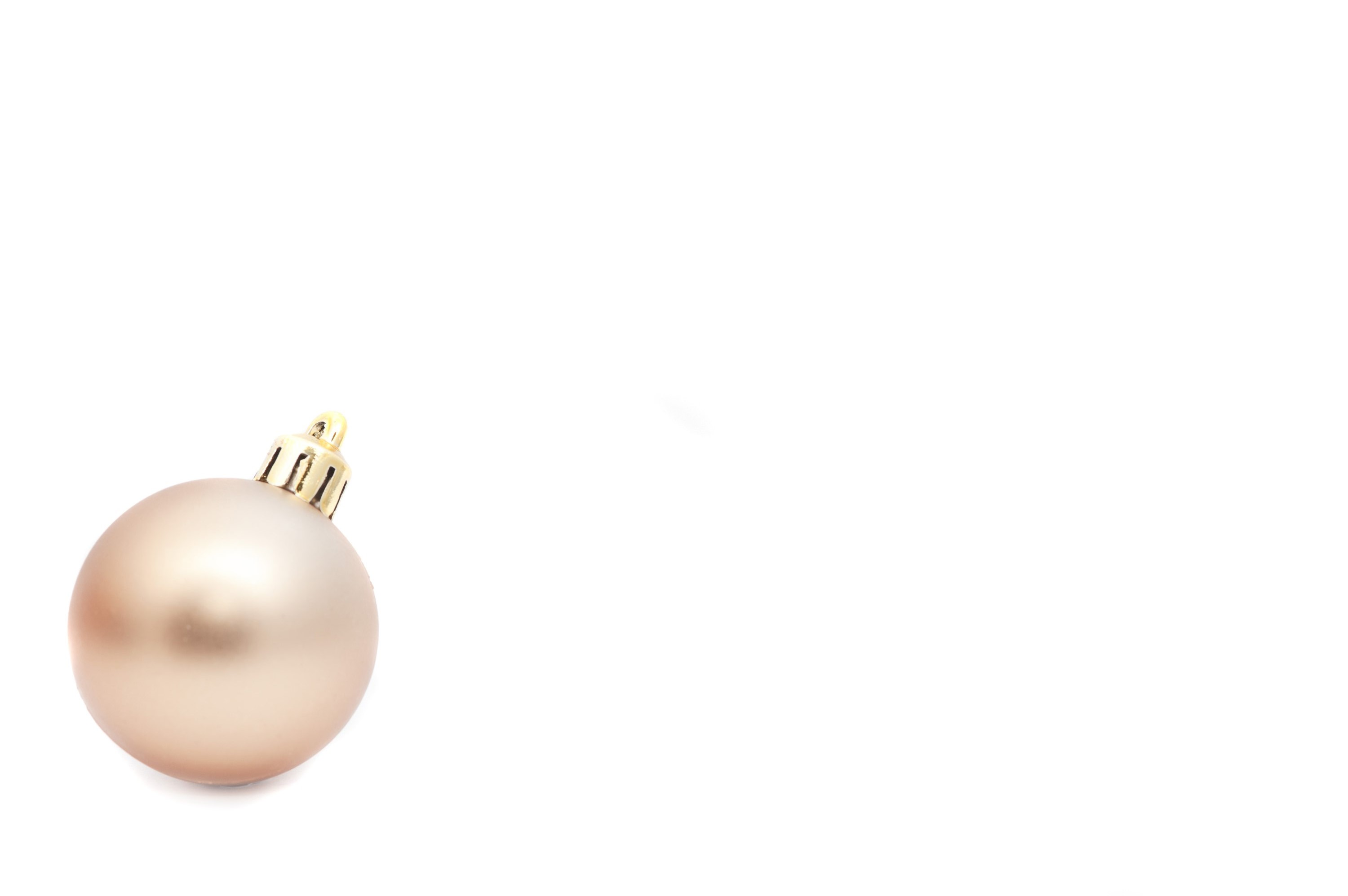 Single gold Christmas bauble with a huge white copy space for your text