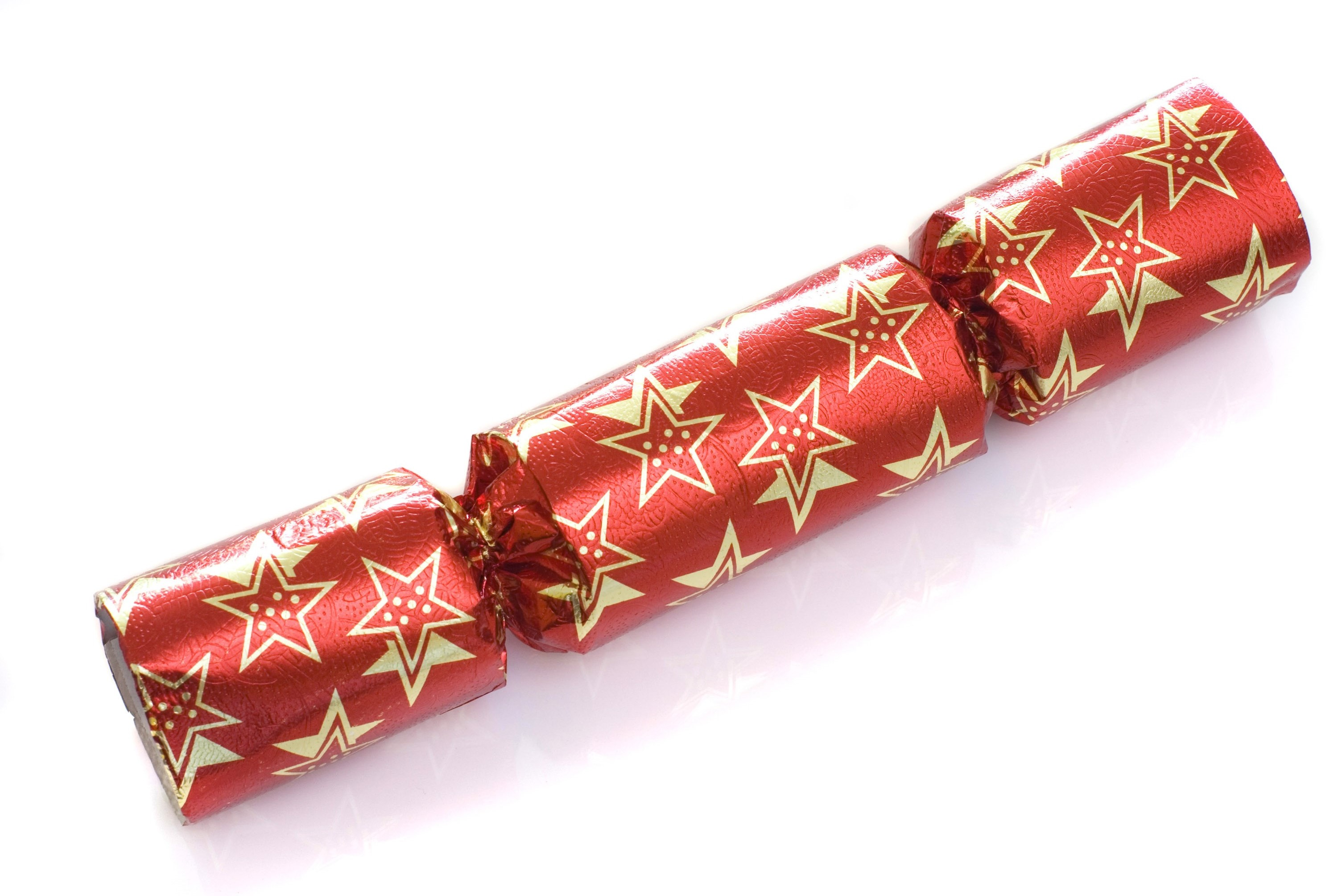 A single red christmas cracker isolated on a white background