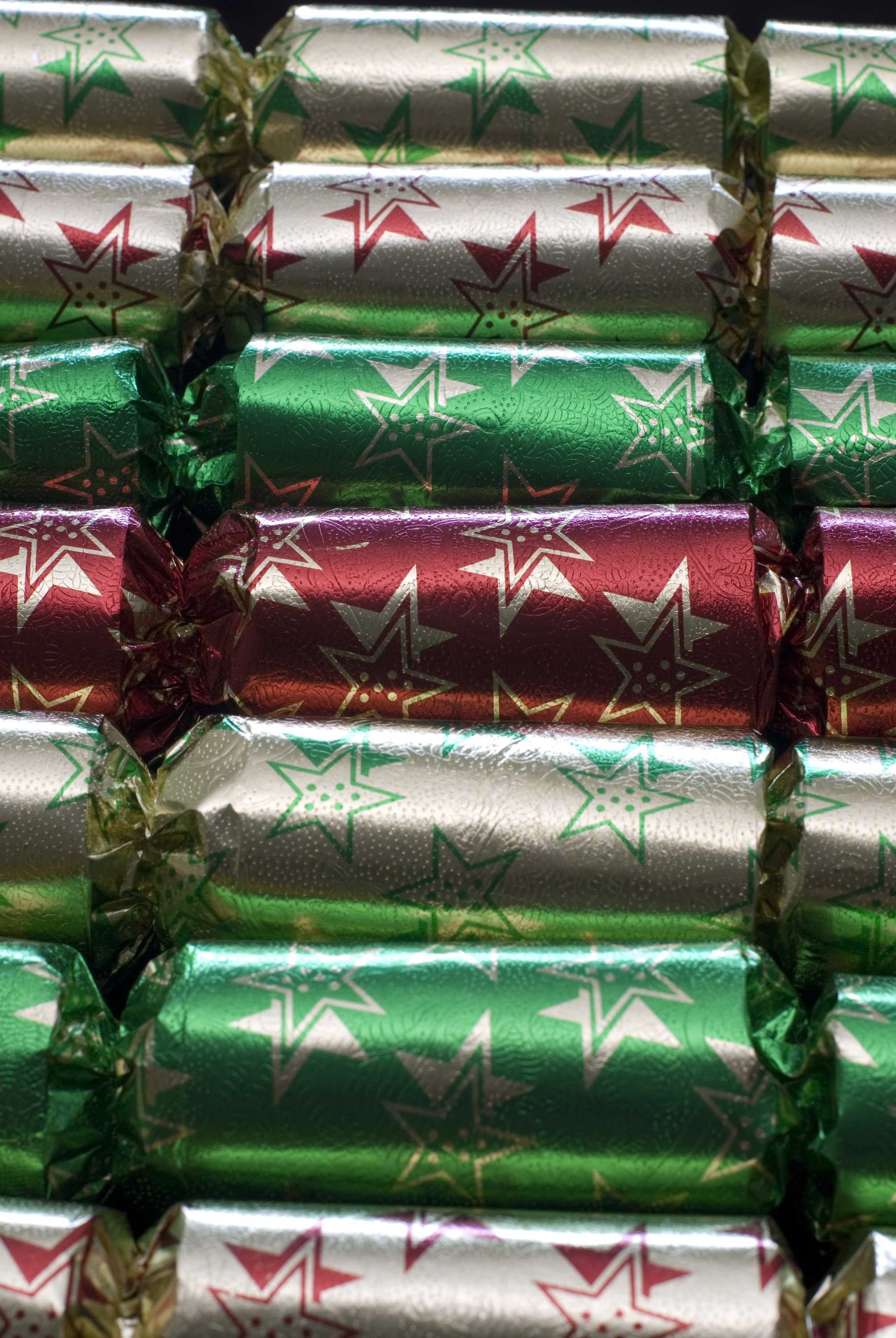 a line of christmas crackers arranged in parallel