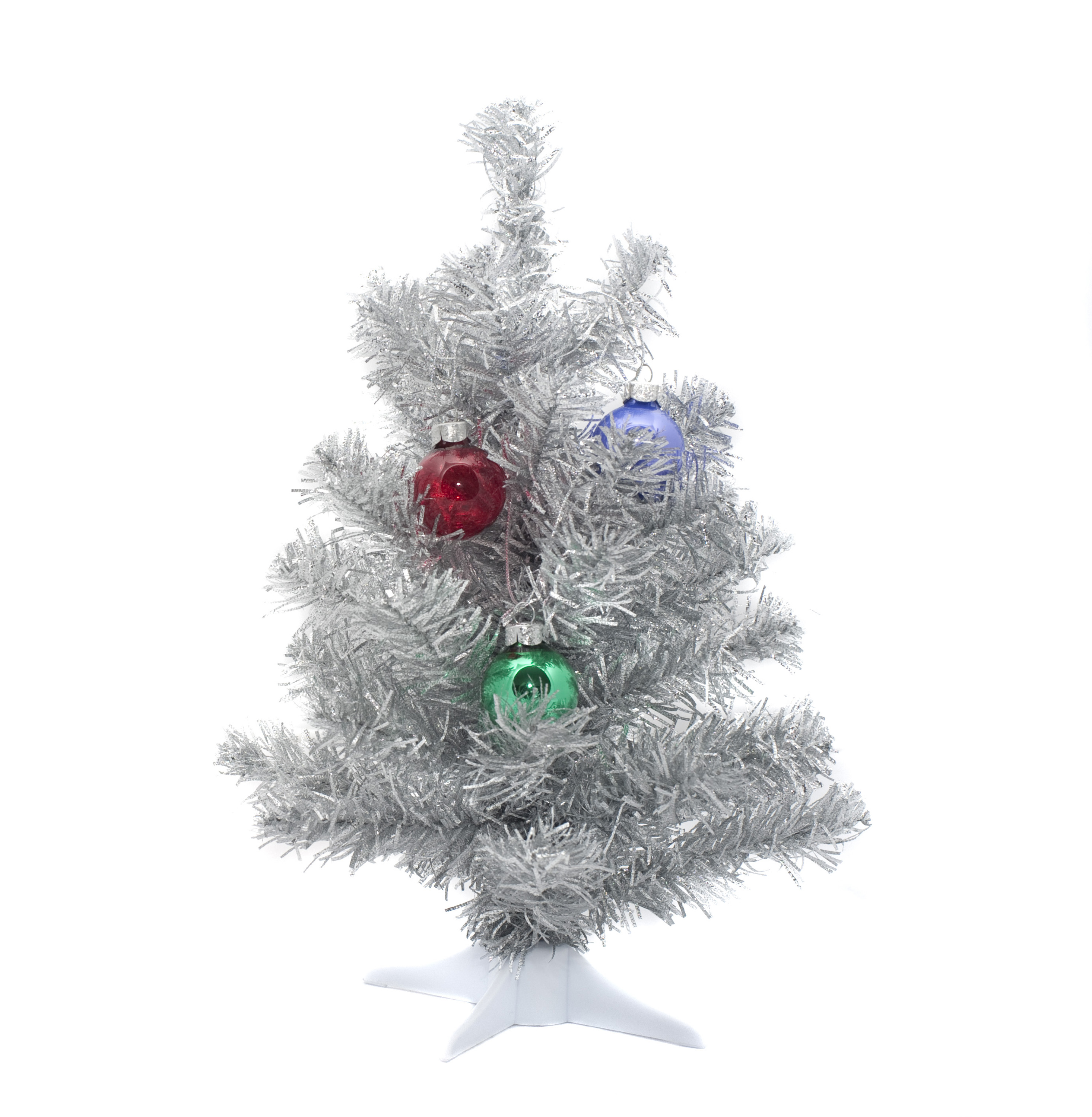 a mini silver plastic christmas tree and hanging ornaments