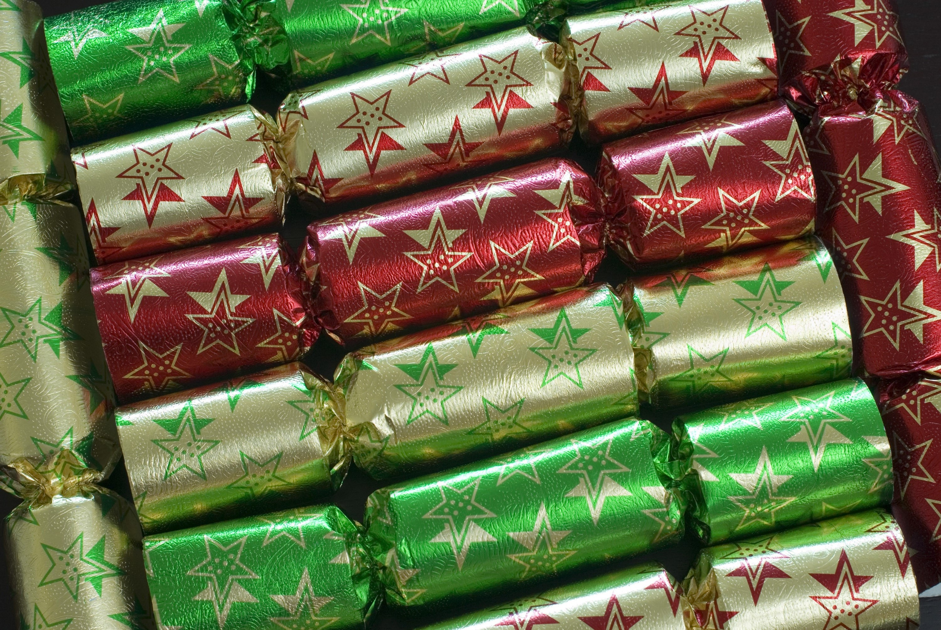 a background image of christmas crackers arranged at different angles