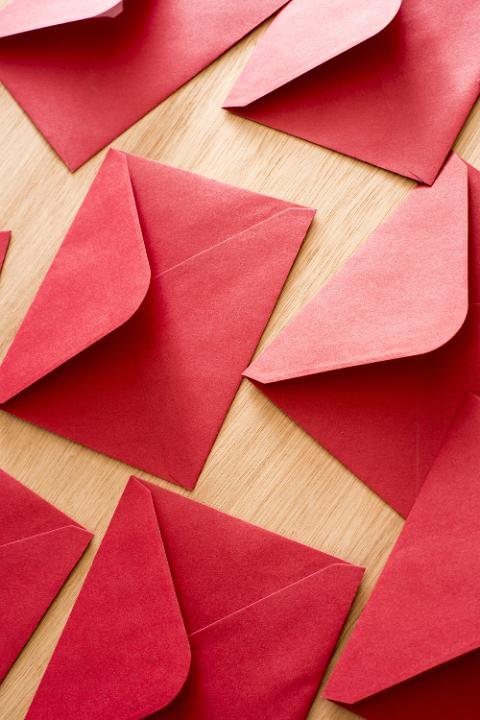 Photo of Festive red Christmas or Valentines envelopes ...