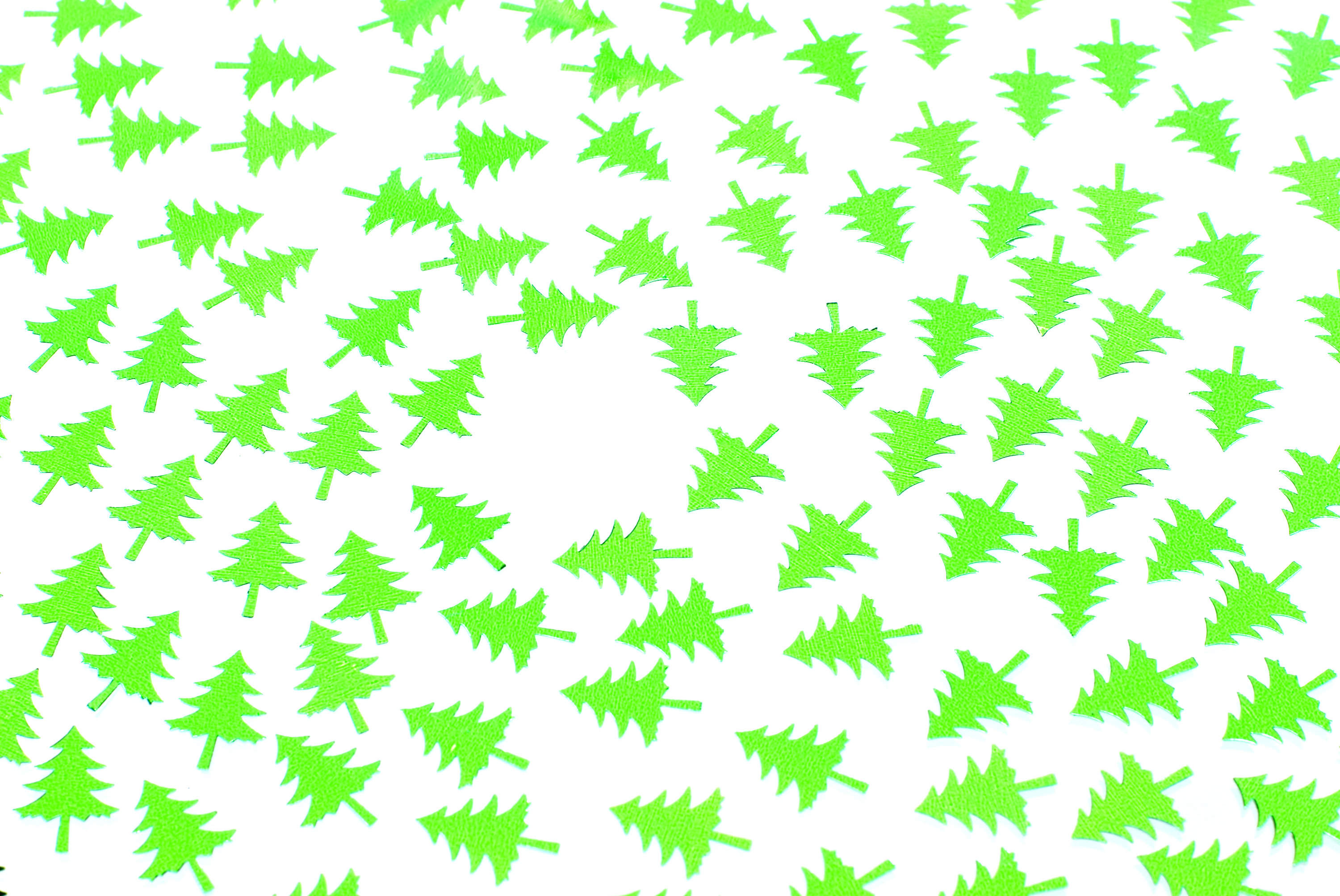 a background of green christmas tree shapes arranged in a spiral pattern