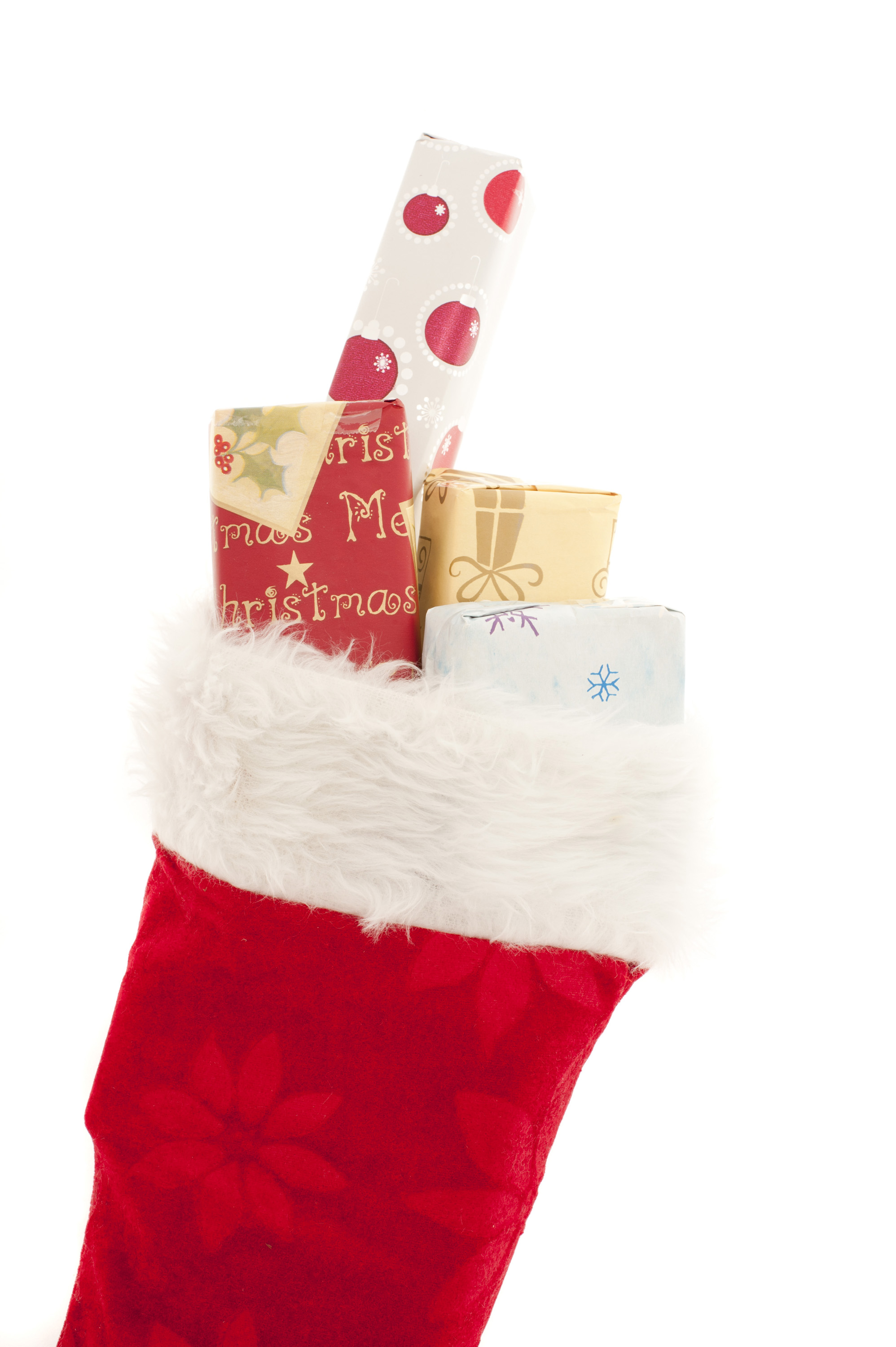 Festive red Xmas stocking filled with colorful Christmas gifts to celebrate the holiday season isolated on white