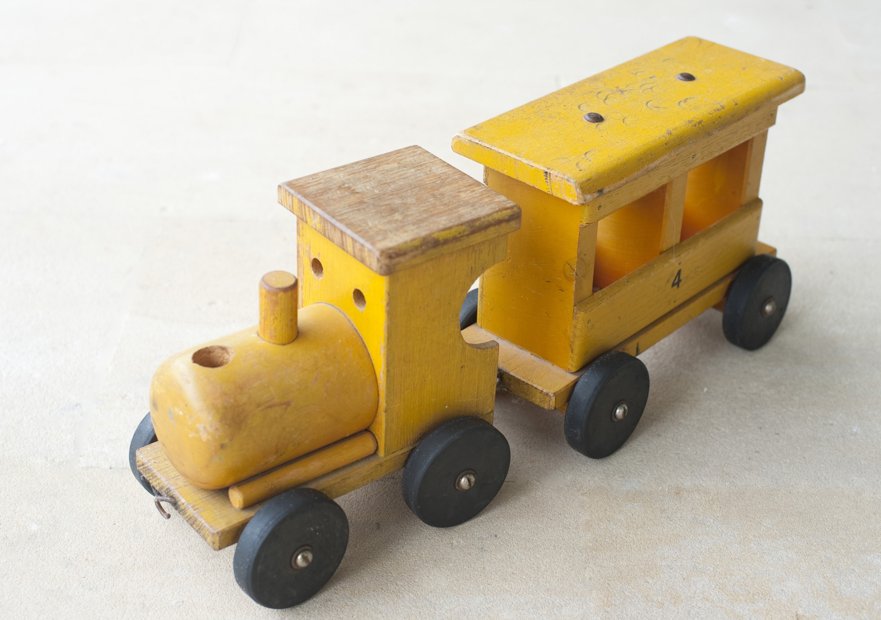Small wooden toy train ornament to decorate a Christmas arrangement or tree