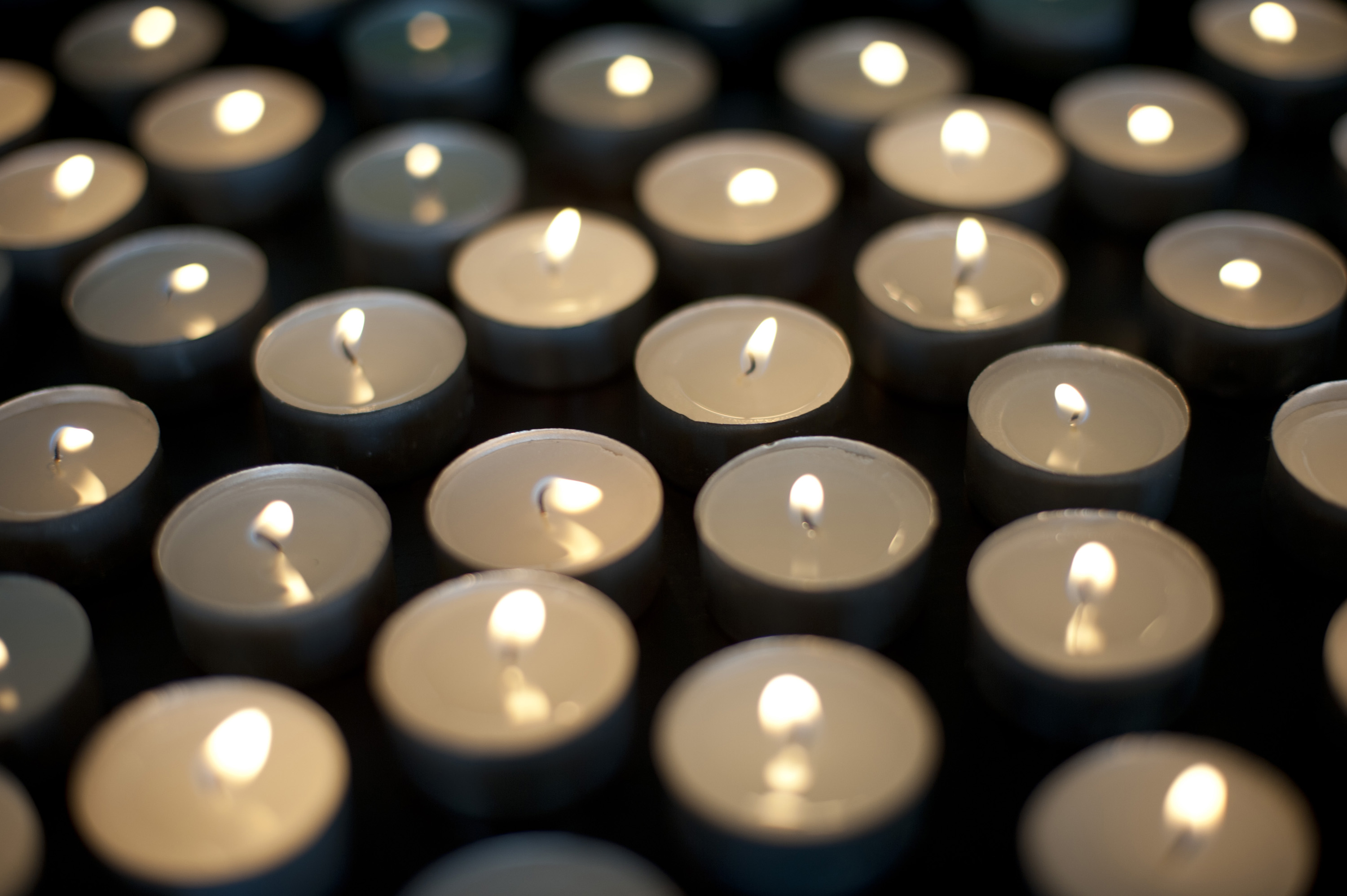 a background image of many burning christmas tealight candles
