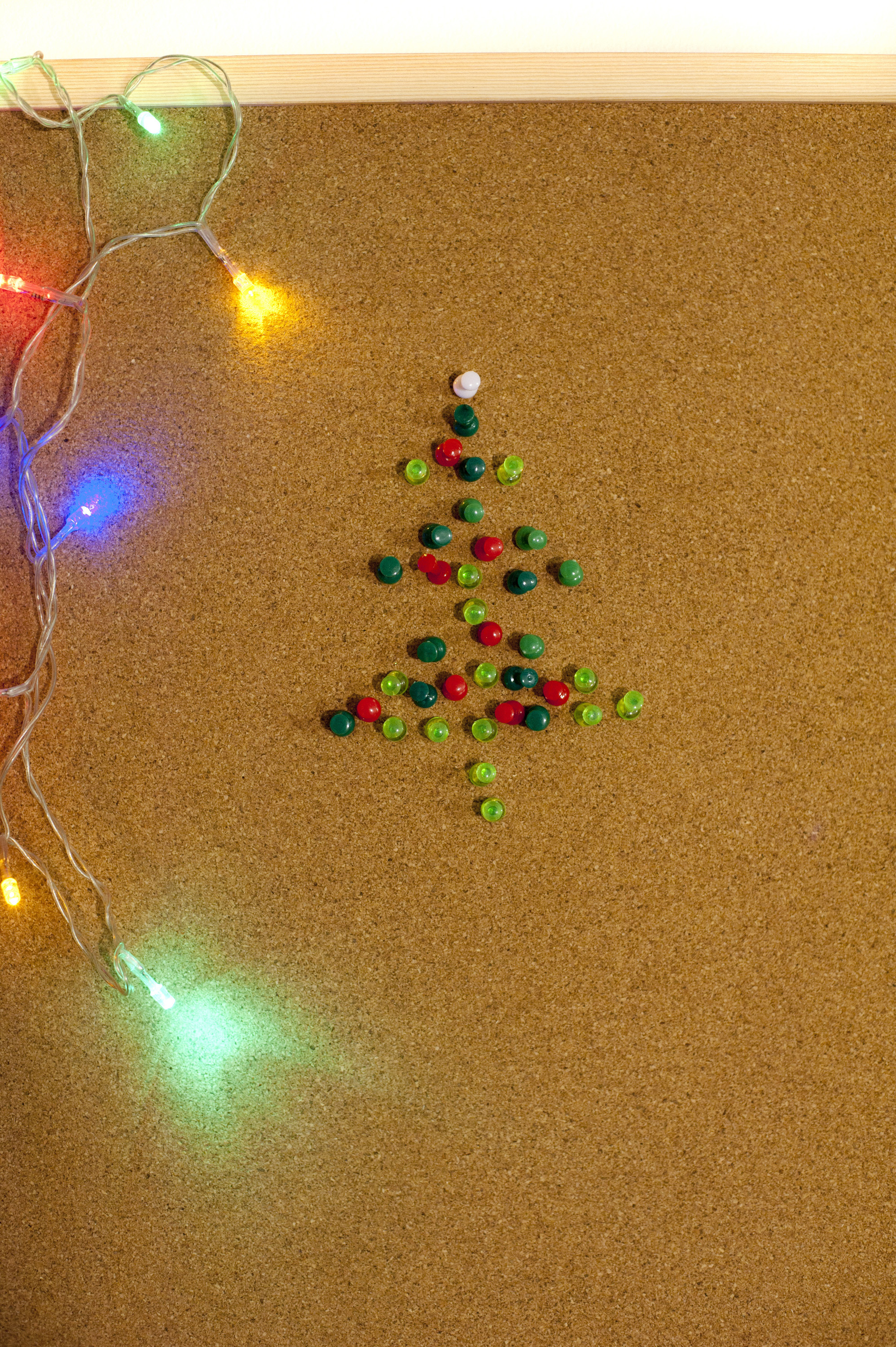 Handmade Christmas tree made of pins, colorful garland
