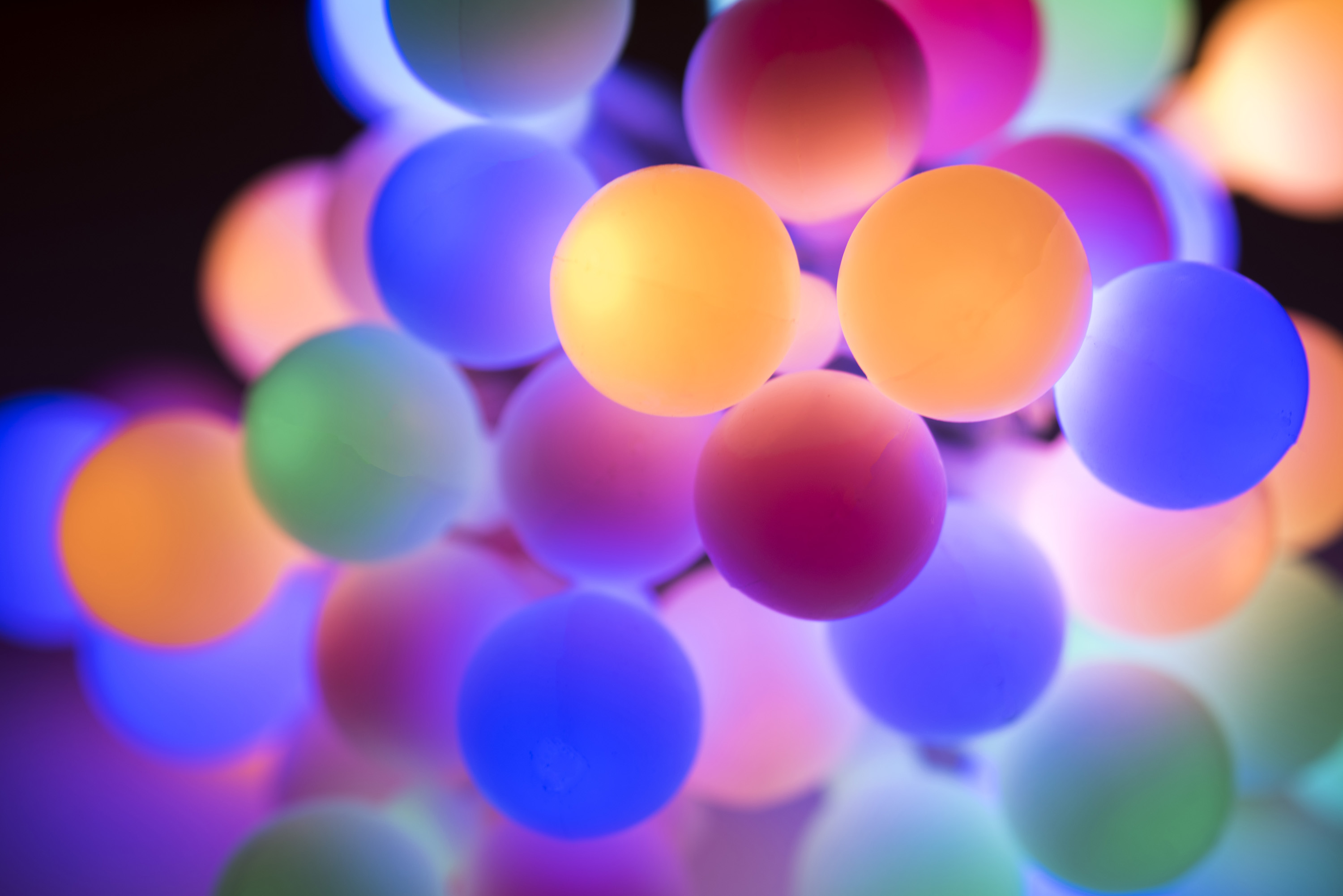 Abstract and defocused background composed of round glowing christmas lights