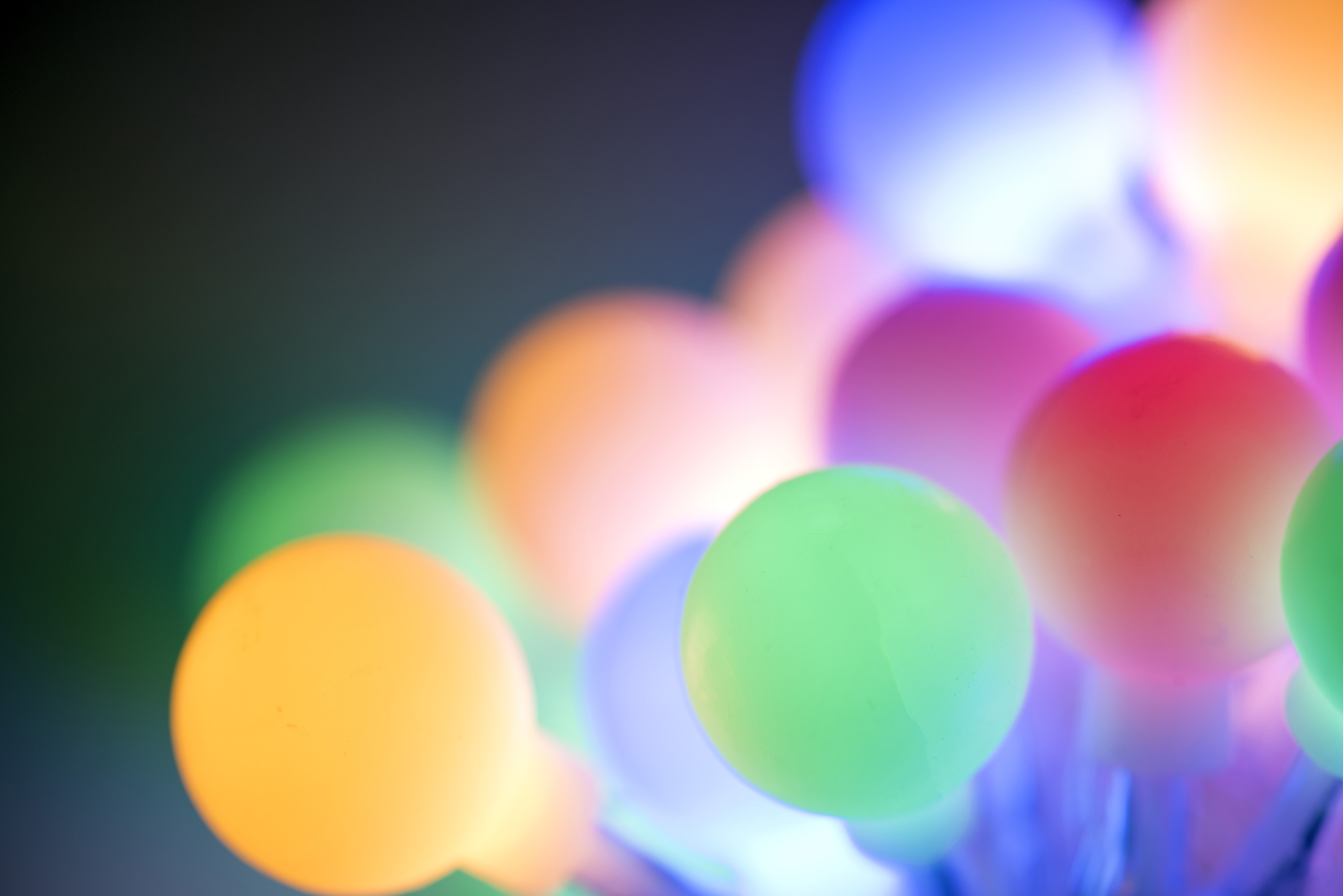 Diffuse background of pastel coloured christmas ball lights
