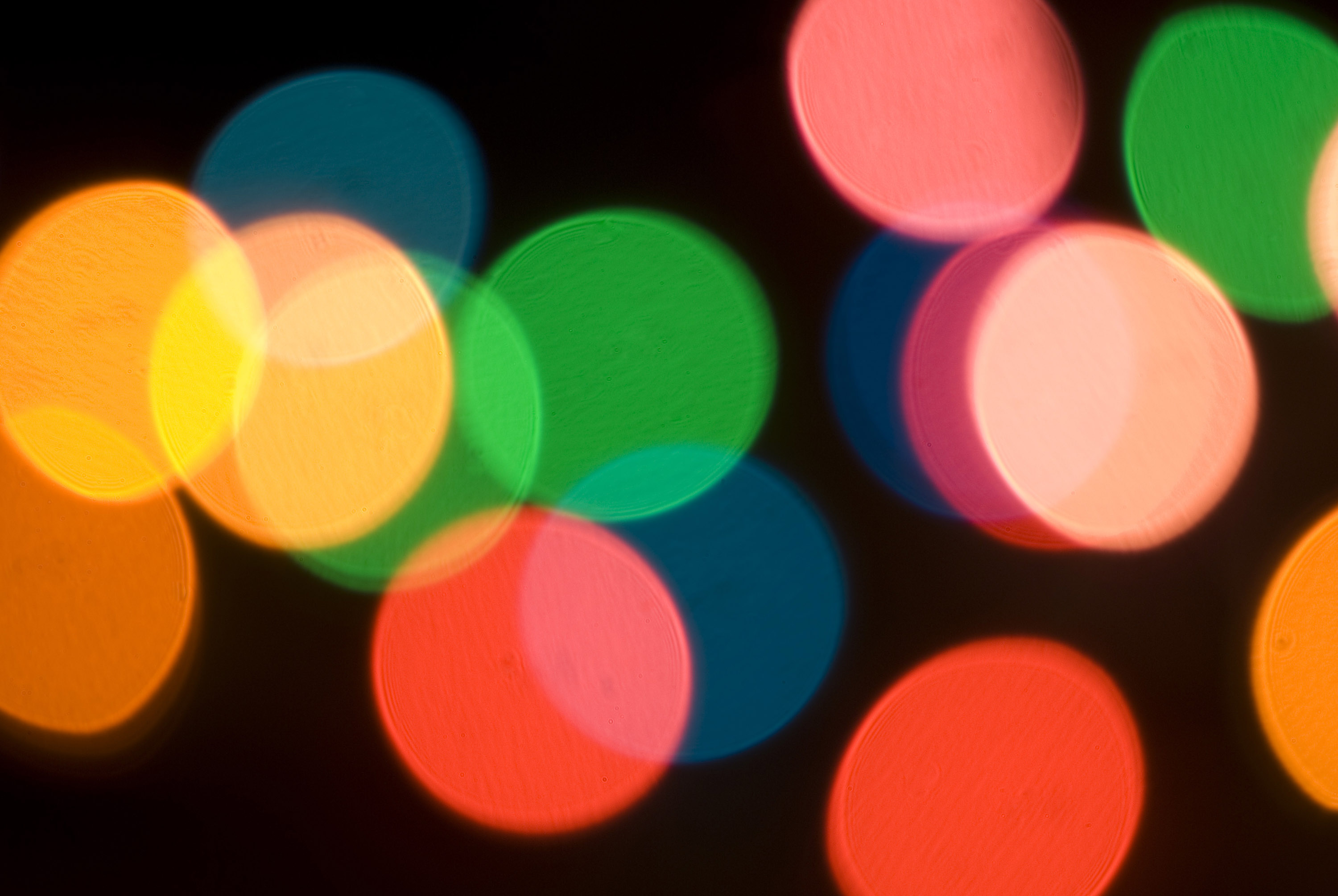 defocused bokeh image of colourful christmas fairy lights