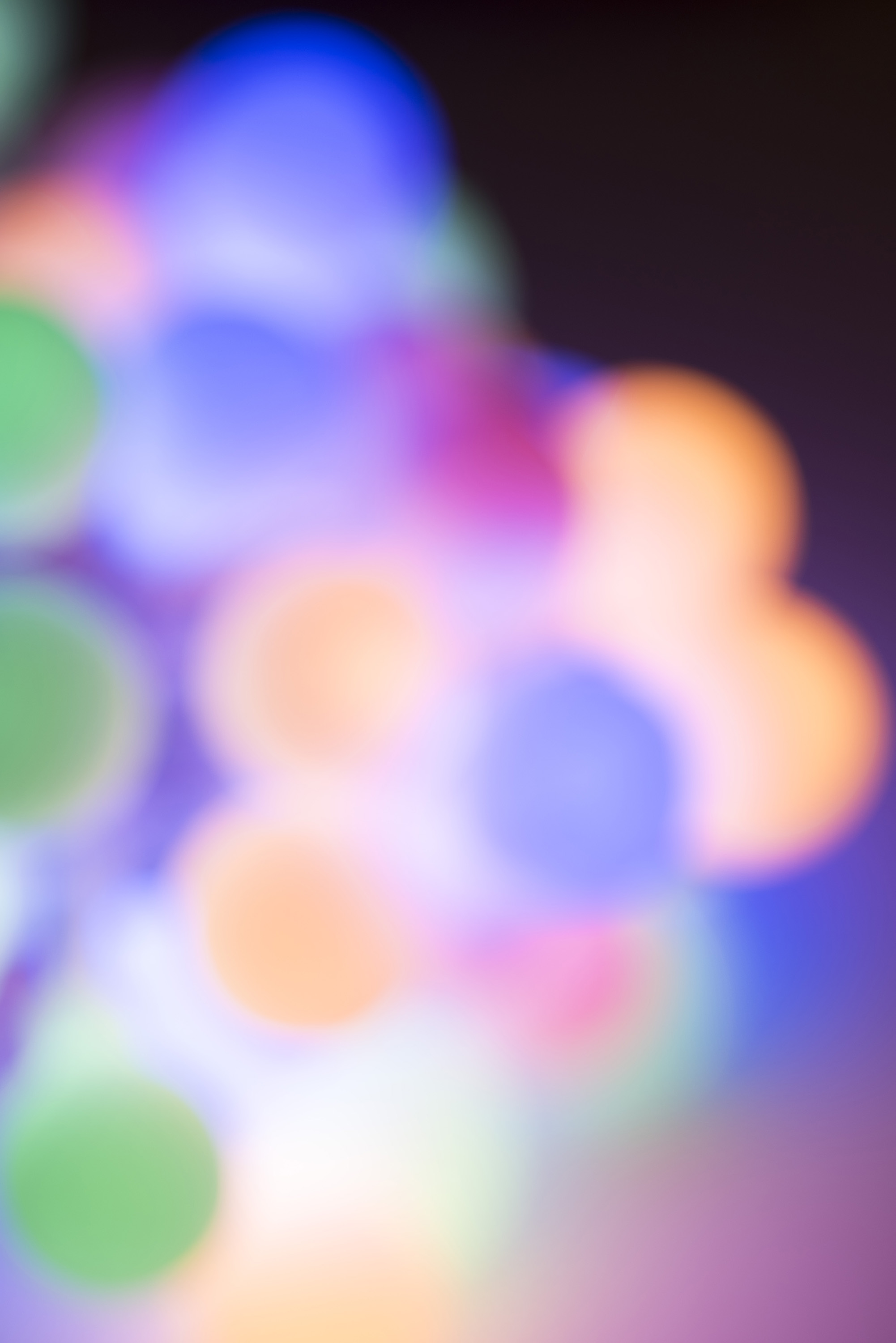 Defocused colorful Christmas lights background of multicolored round lights in a cluster with copy space for your holiday or seasonal message