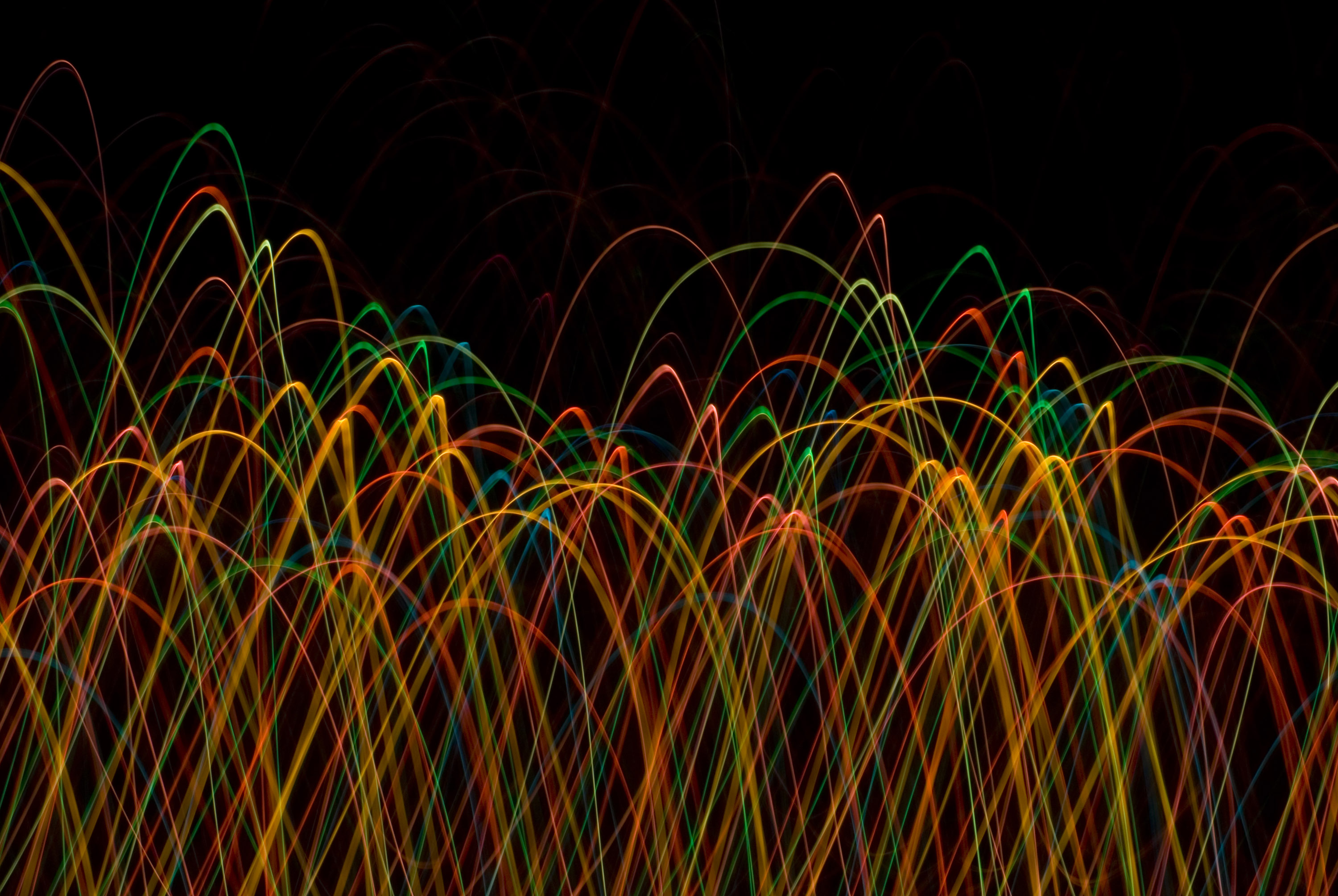 abstract background of red orange and green light trails