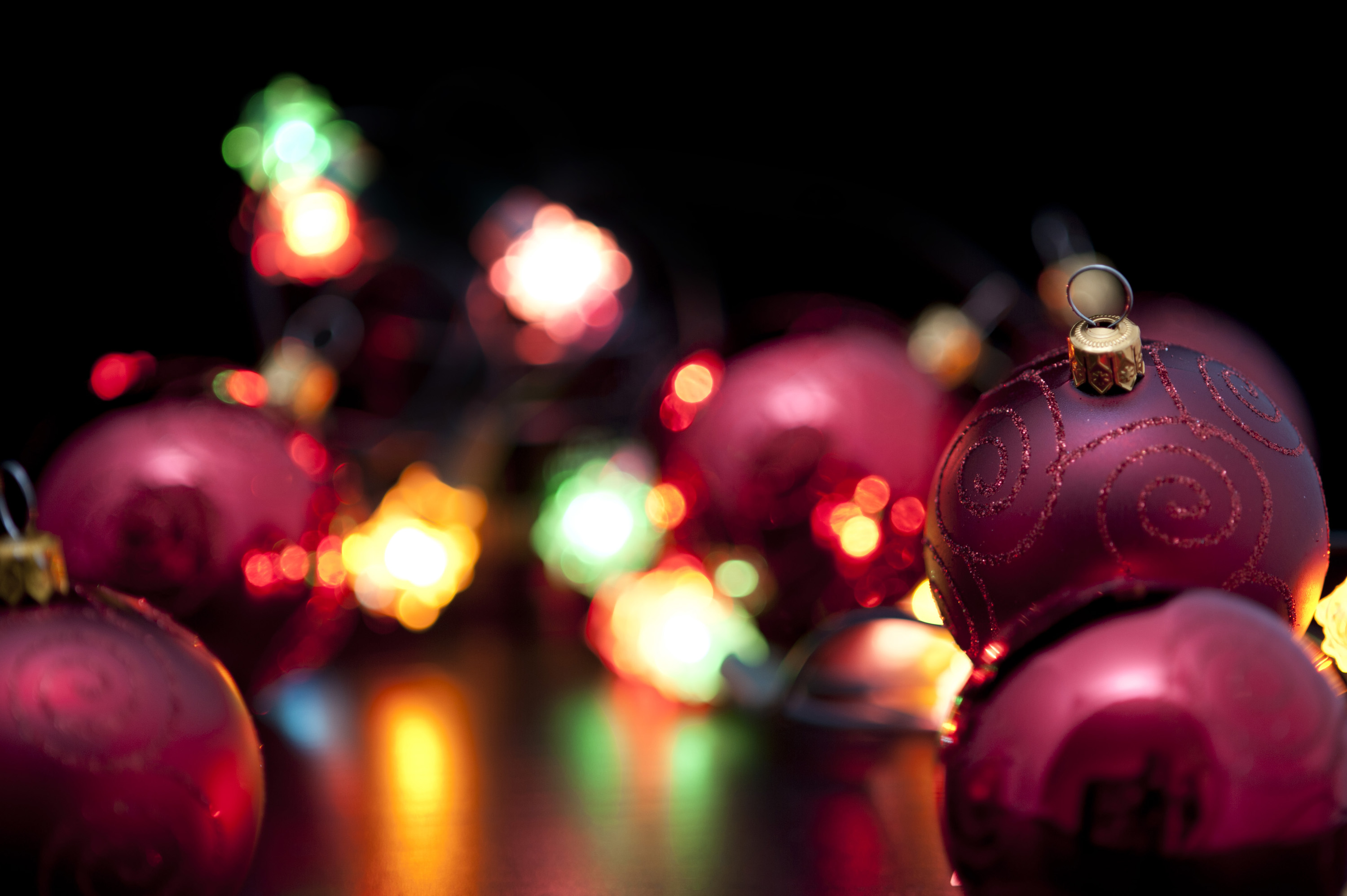 Brightly coloured party lights illuminating Christmas baubles and ...