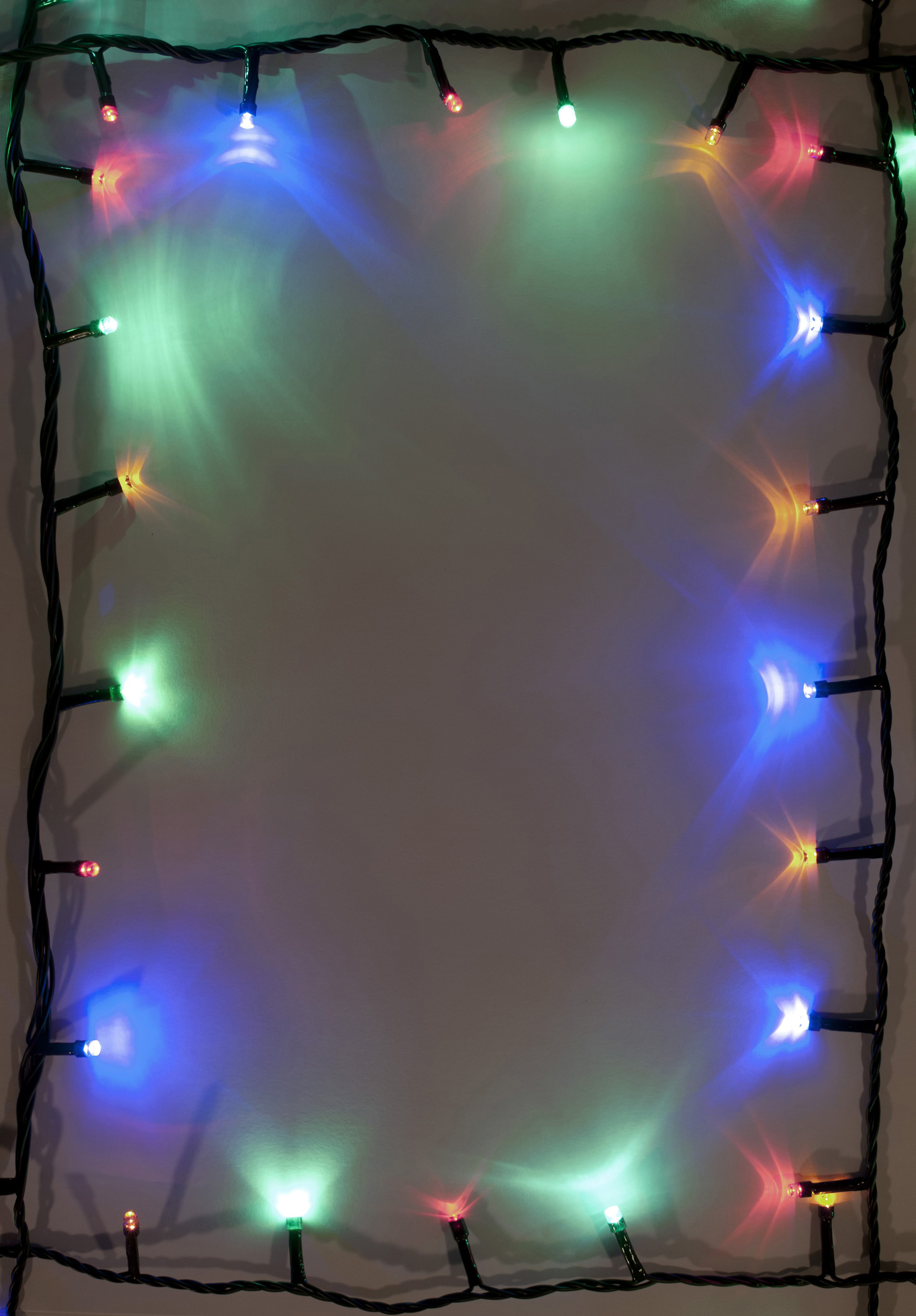 Lighted brigtful garland around the edges. Copy space