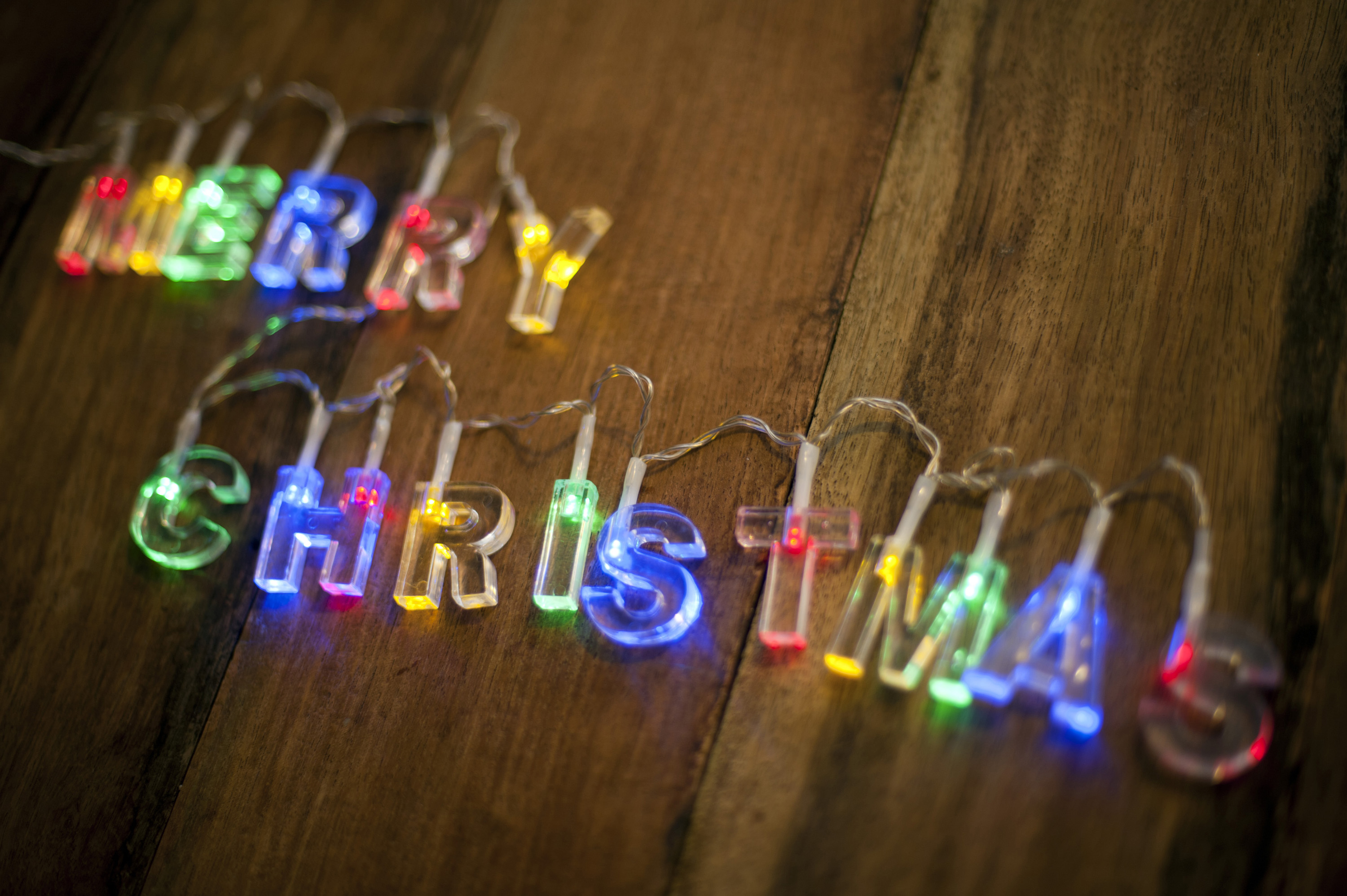 Close-up of Merry Christmas lighted garland