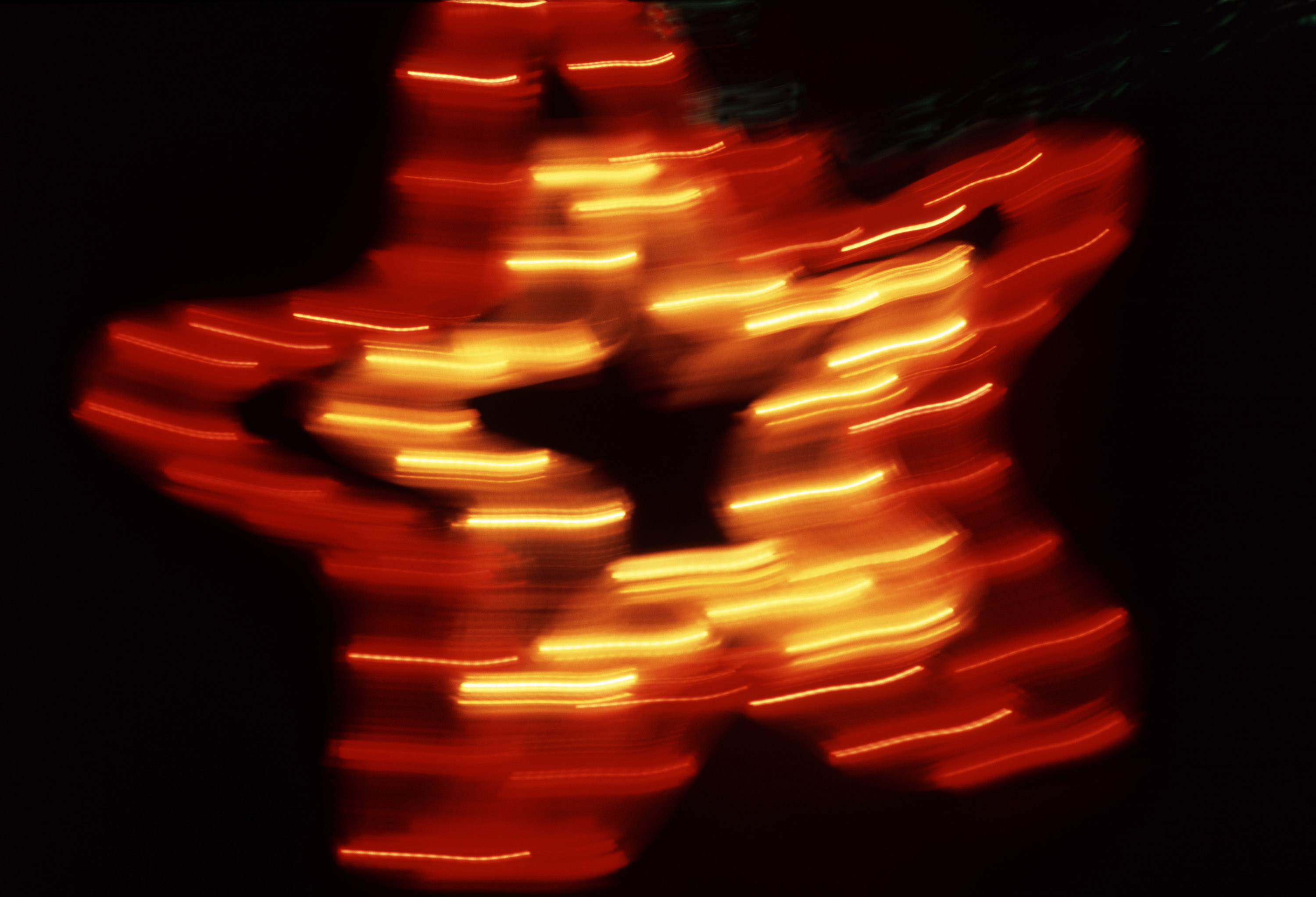 blurred: a red and yellow illuminated christmas star