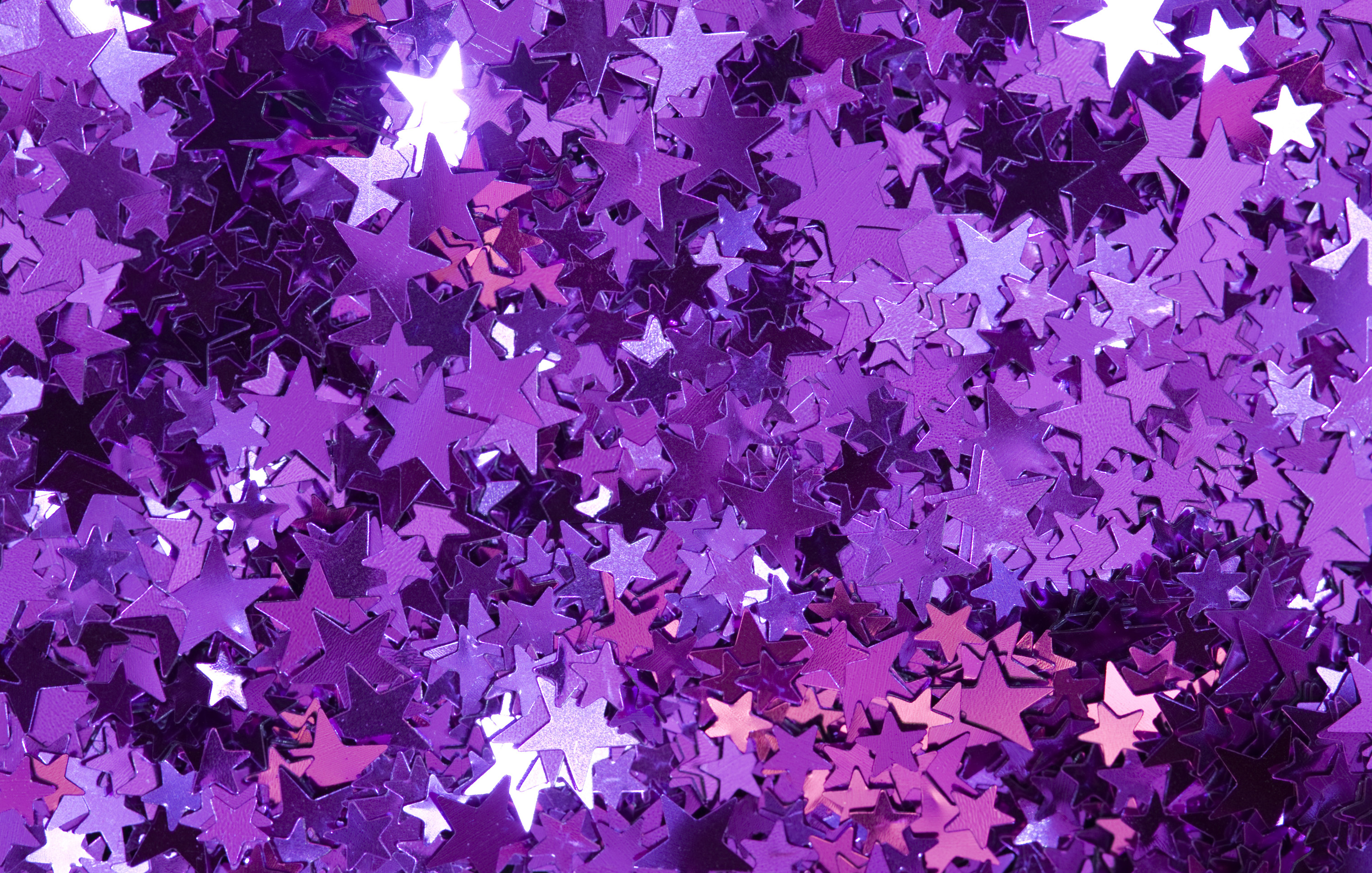 A Bright Colorful Background Of Sparkling Reflective Stars