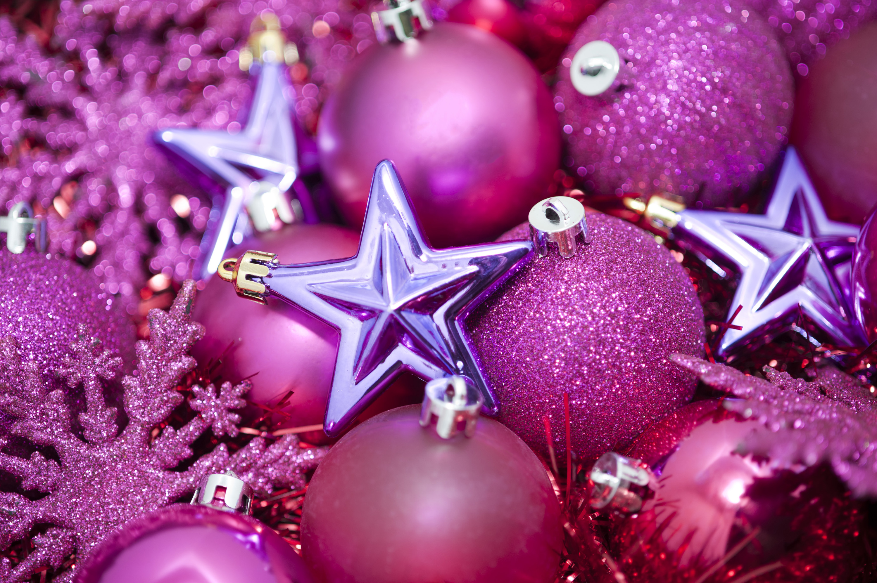 Superb Pink Camo Christmas Ornaments Part - 12: A Festive Holiday Background With Pink Coloured Glittery Christmas Tree  Ornaments On A Bed Of Sparkling