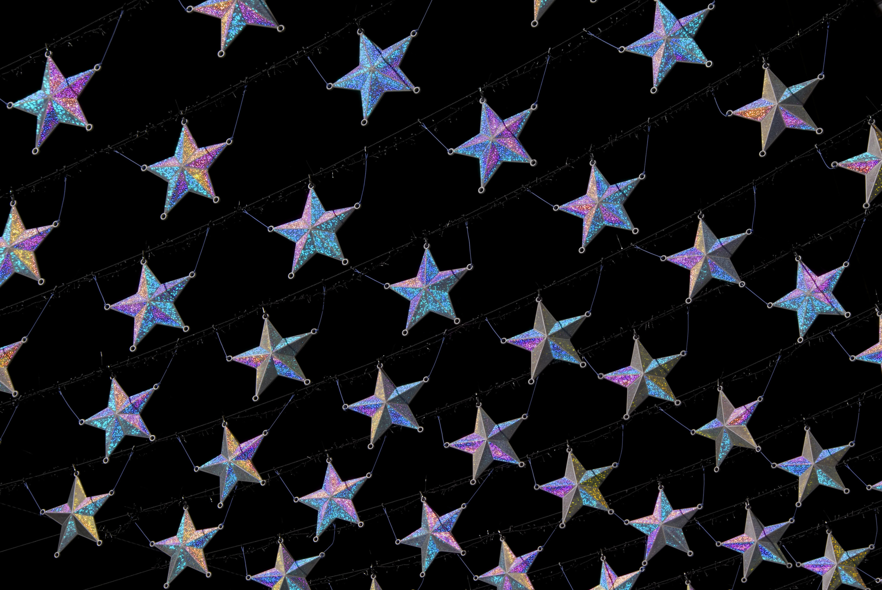 Photo of christmas star background free christmas images christmas star background with diagonal rows of silver stars with a purple hghlight on a black voltagebd Gallery