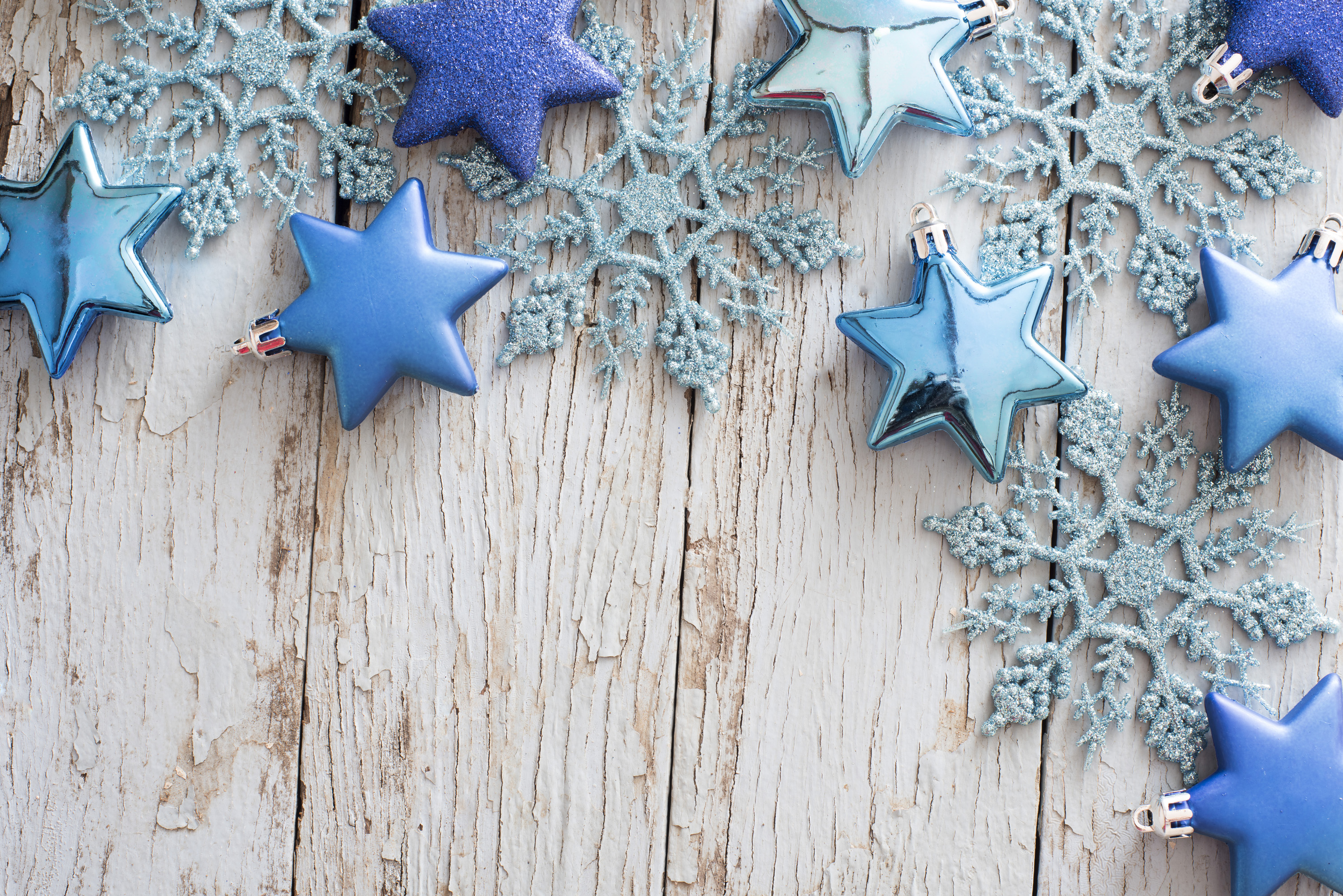 corner border of blue christmas stars and snowflakes on a background of weathered rustic old wooden - Blue Christmas Background