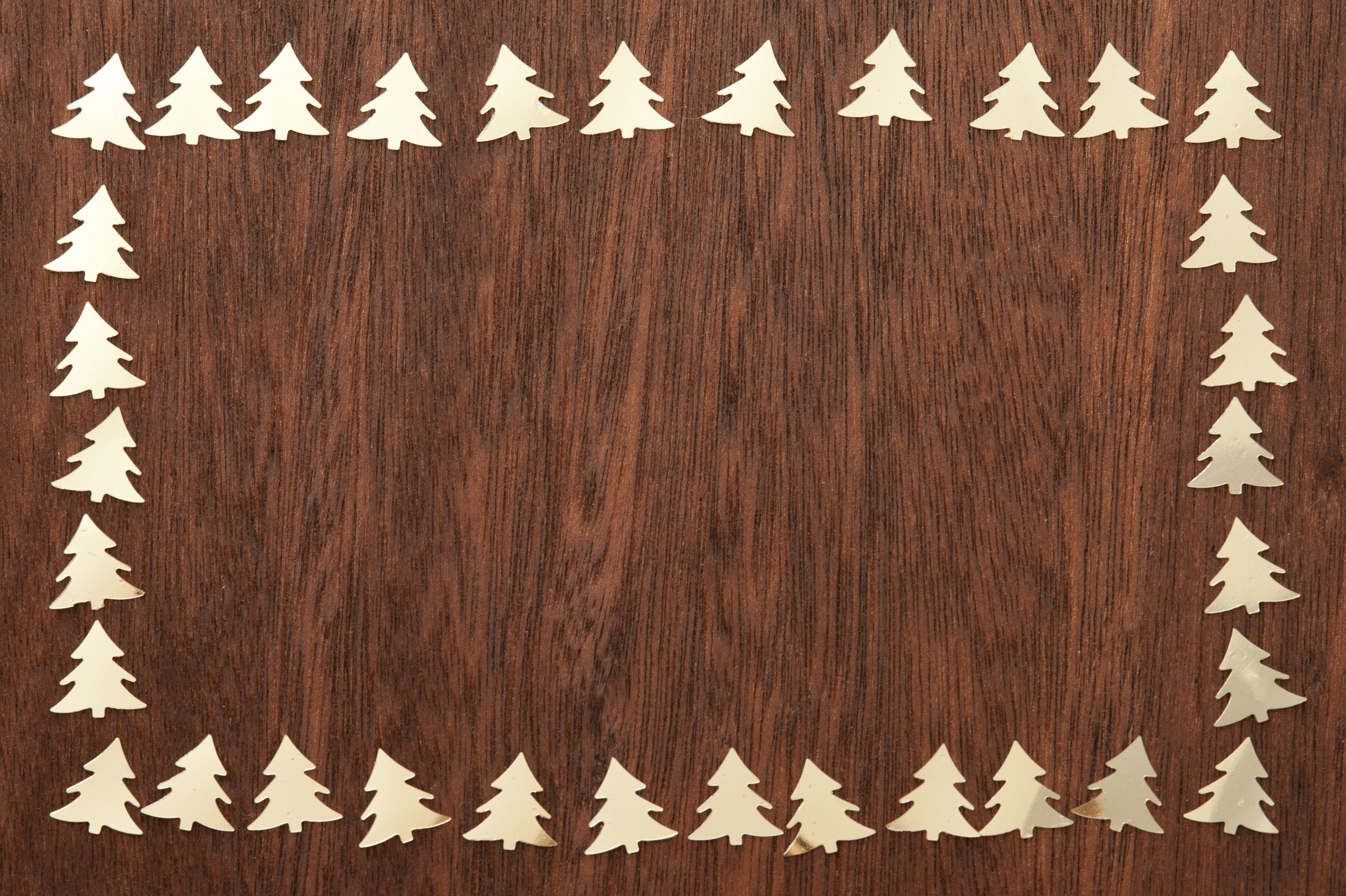 Wood christmas tree cutout - Cut Out Golden Christmas Trees Lying Around Edges On Wooden Table From Above