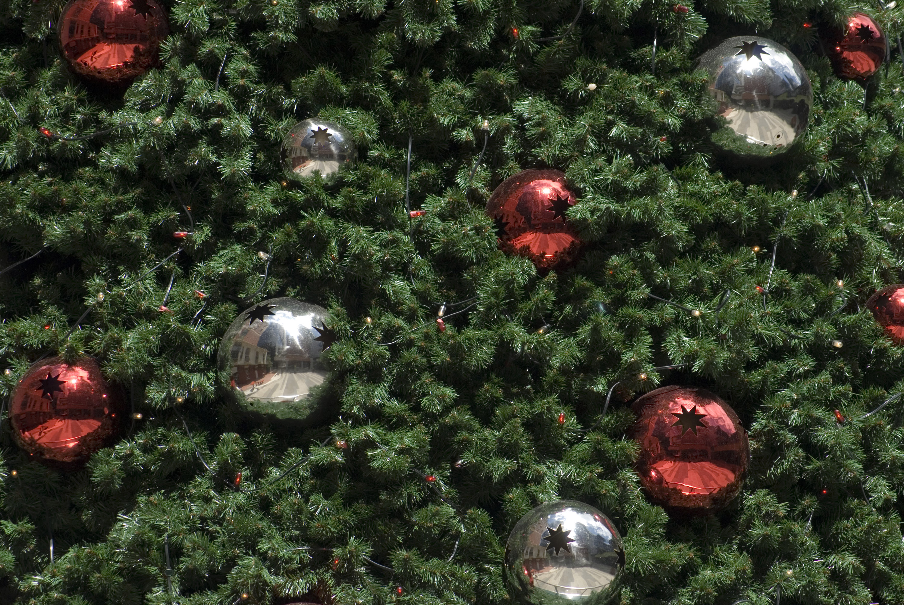 An Artificial Christams Tree With Red And Silver Baubles