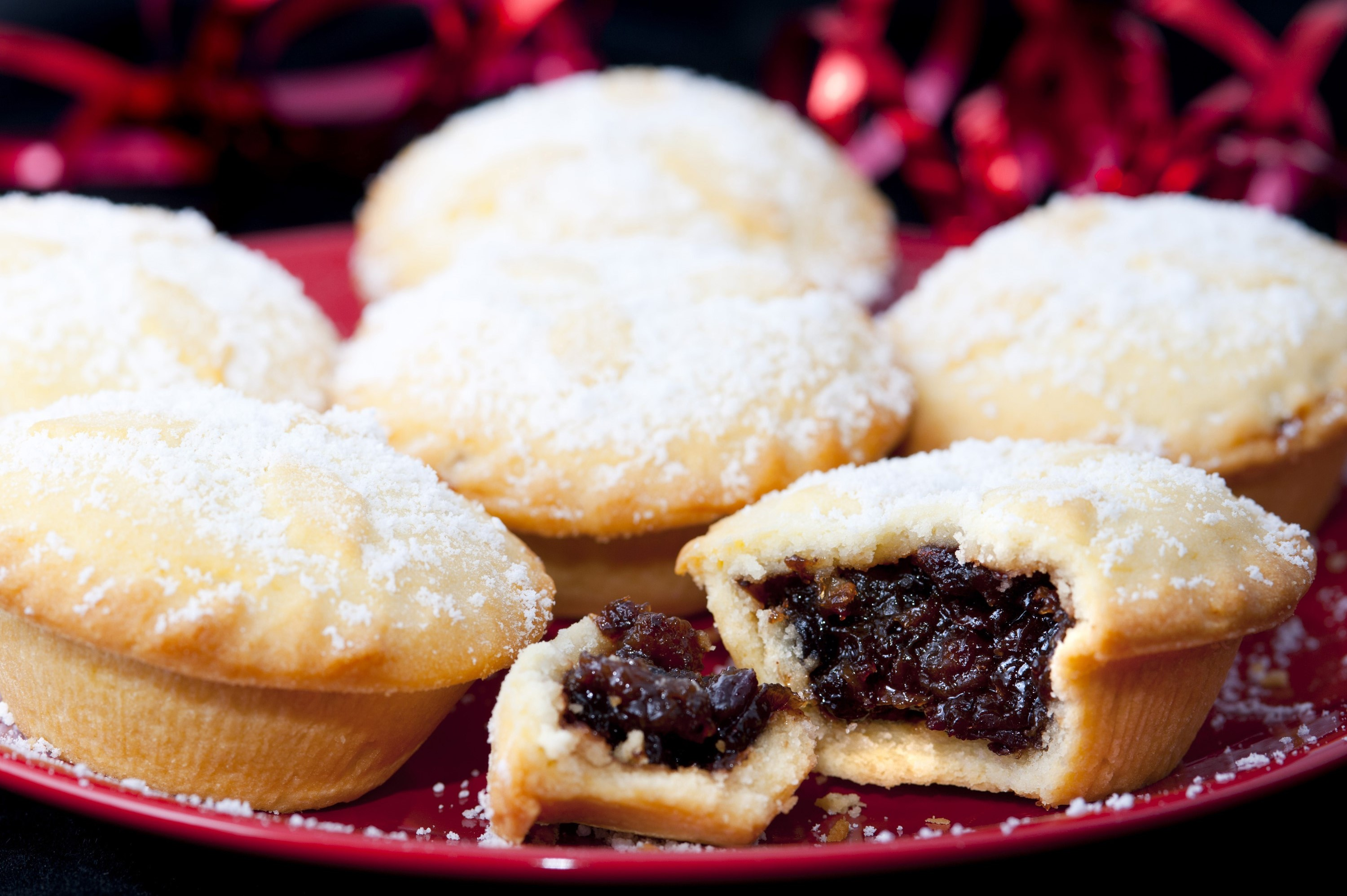 Freshly baked fruity Christmas mince pie broken open to reveal the filling rich in spices and & Photo of Freshly baked fruity Christmas mince pie | Free christmas ...