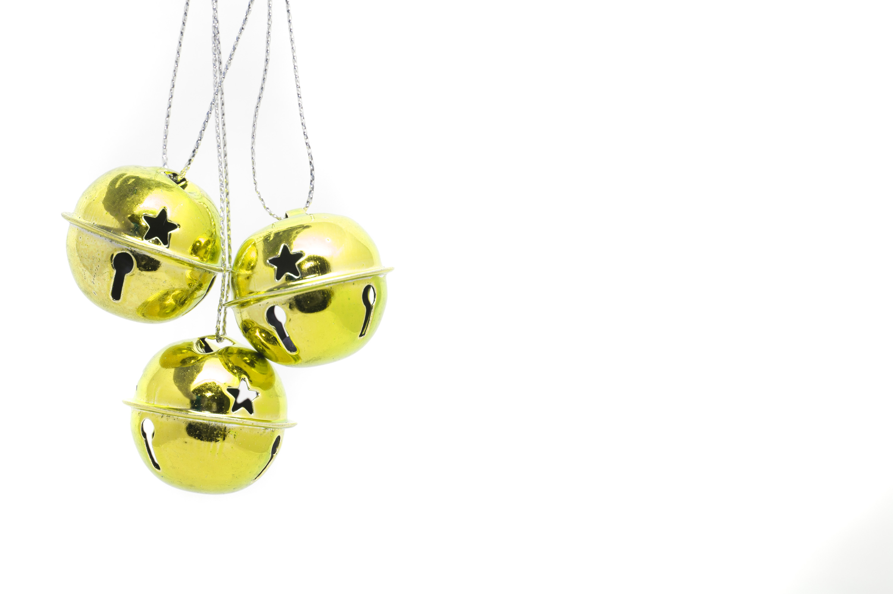 Photo of Hanging gold jingle bells | Free christmas images
