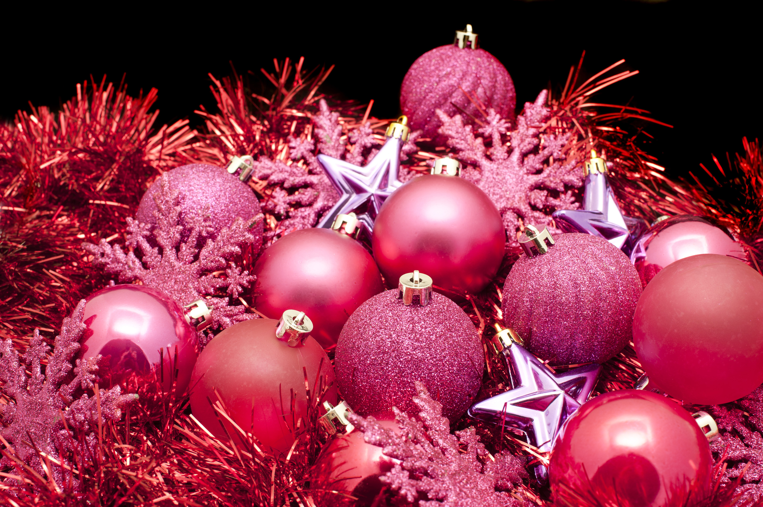 an arrangemnt of red cooured christmas decroations baubles tree ornaments and tinsel - Christmas Decor Catalogs Free