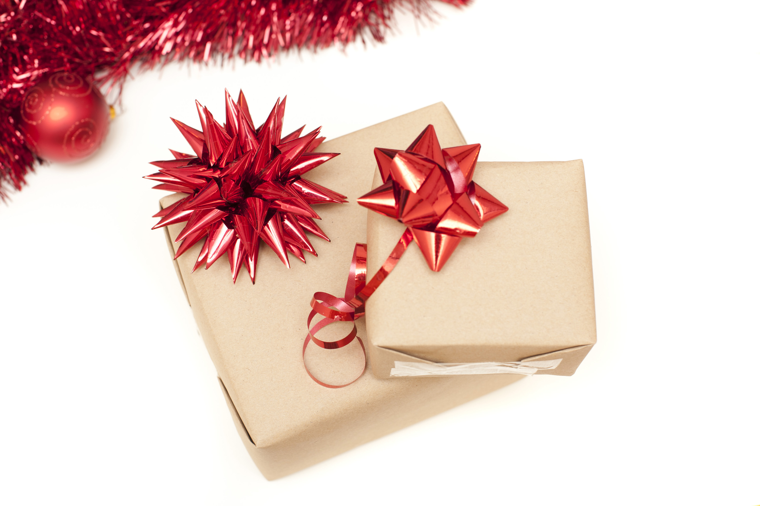 Photo of Two plain wrapped Christmas gifts with bows | Free ...