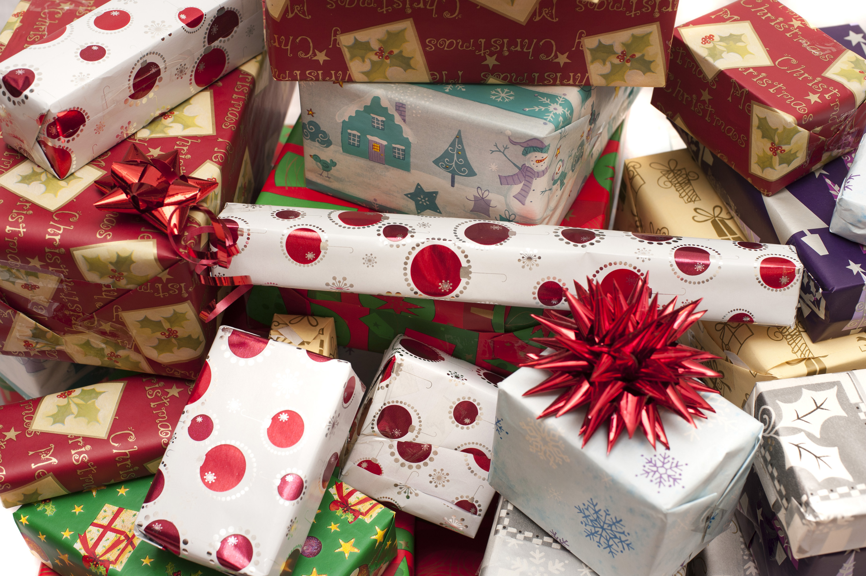 Photo of Pile of decorative colorful Christmas gifts | Free ...