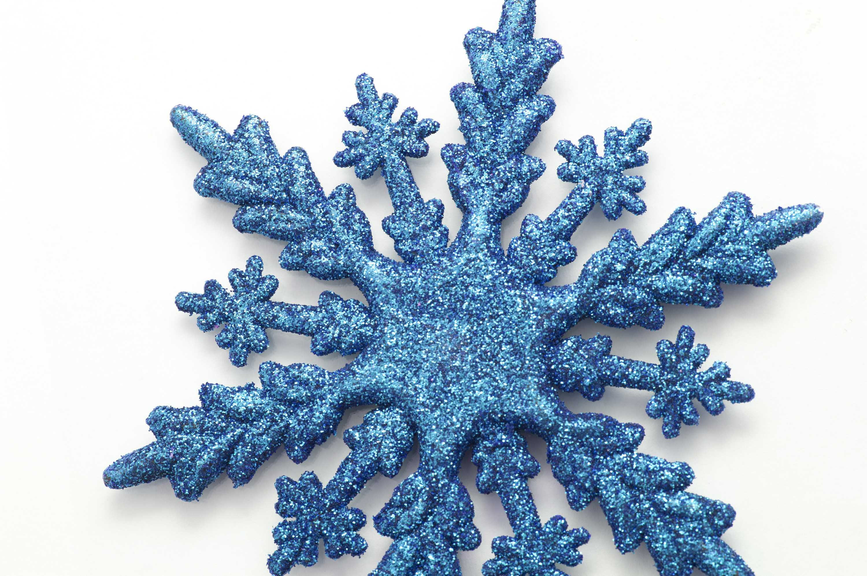 Christmas snowflake ornaments - Decorative Blue Christmas Snowflake Ornament With A Textured Shiny Surface On A White Background
