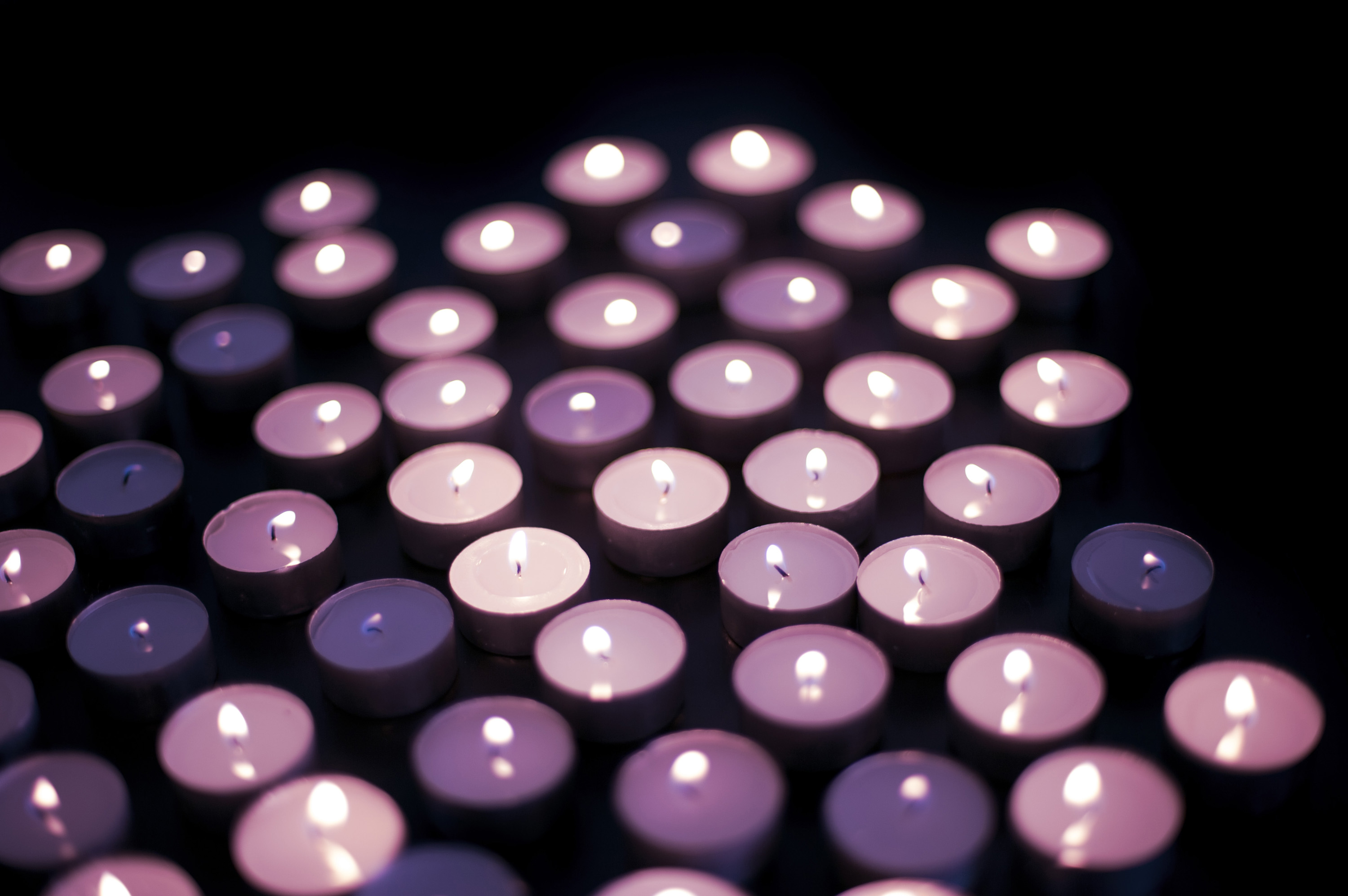 Photo of pink tinted candles free christmas images a large number of pink tinted candles burning in the darkness a symbol of hope buycottarizona Image collections